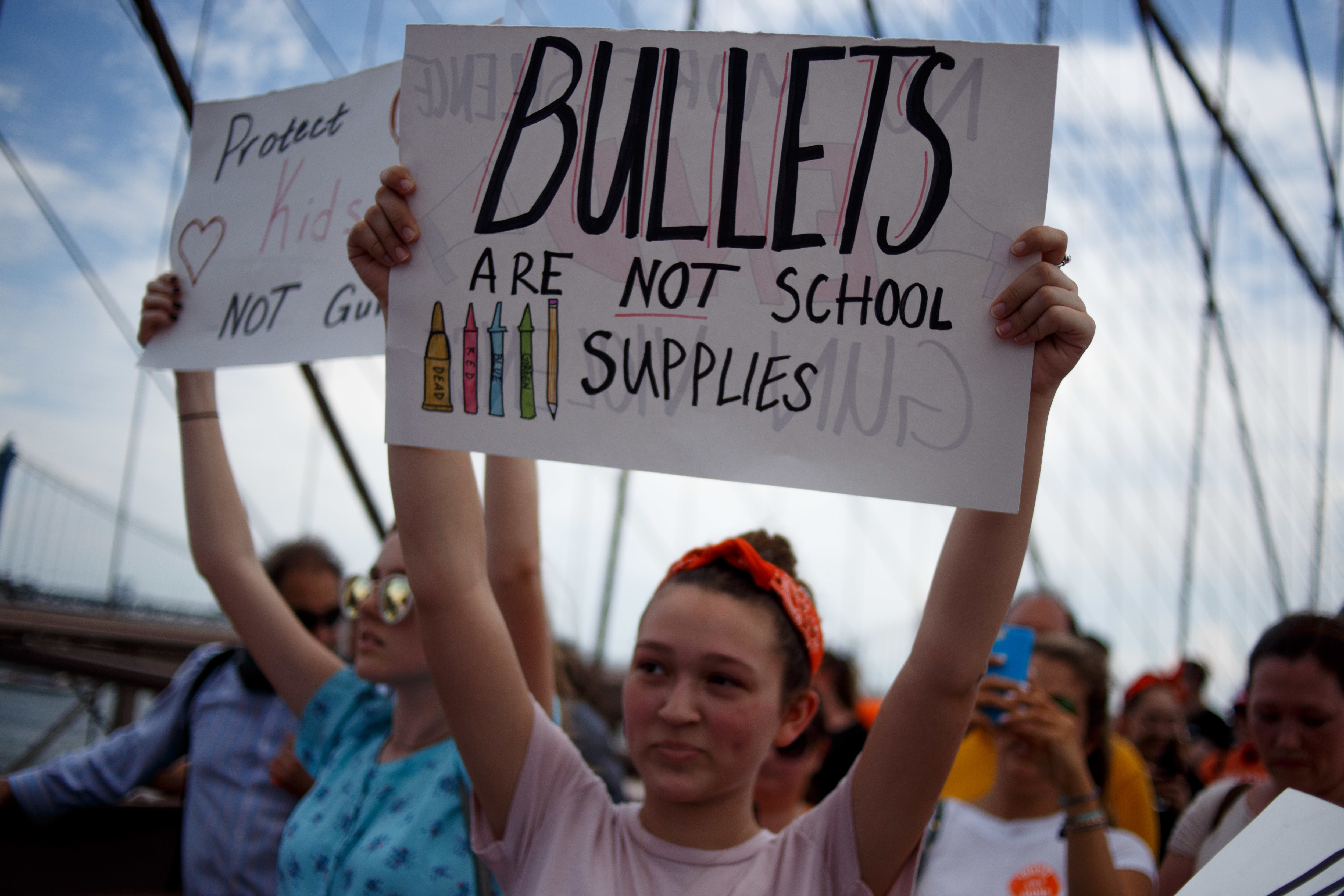 Activists seeking an end to gun violence in American schools and society participate in the Youth Over Guns March, crossing the Brooklyn Bridge into Manhattan.