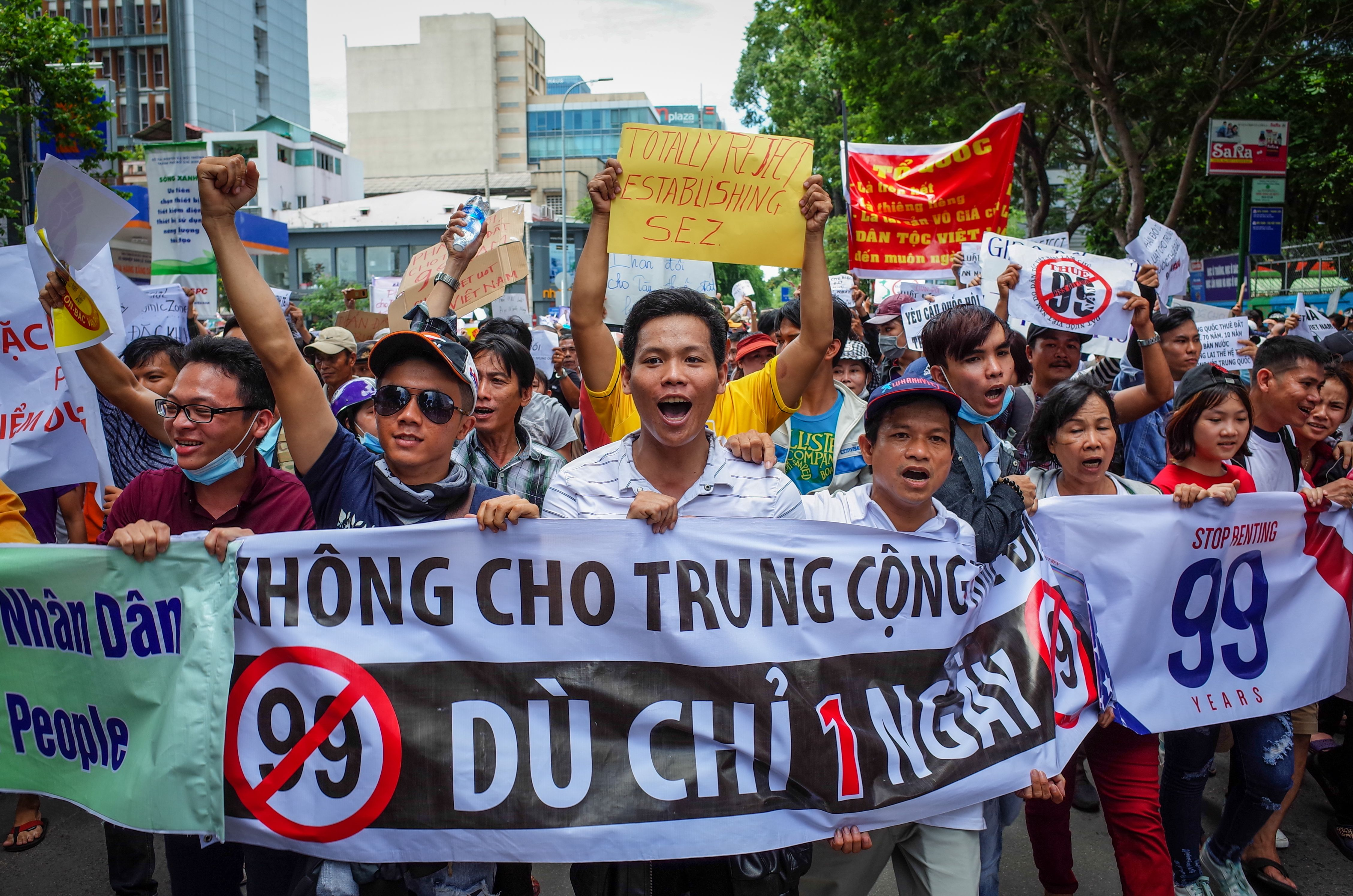 Vietnamese protesters shout slogans against a proposal to grant companies lengthy land leases during a demonstration in Ho Chi Minh City on June 10, 2018.