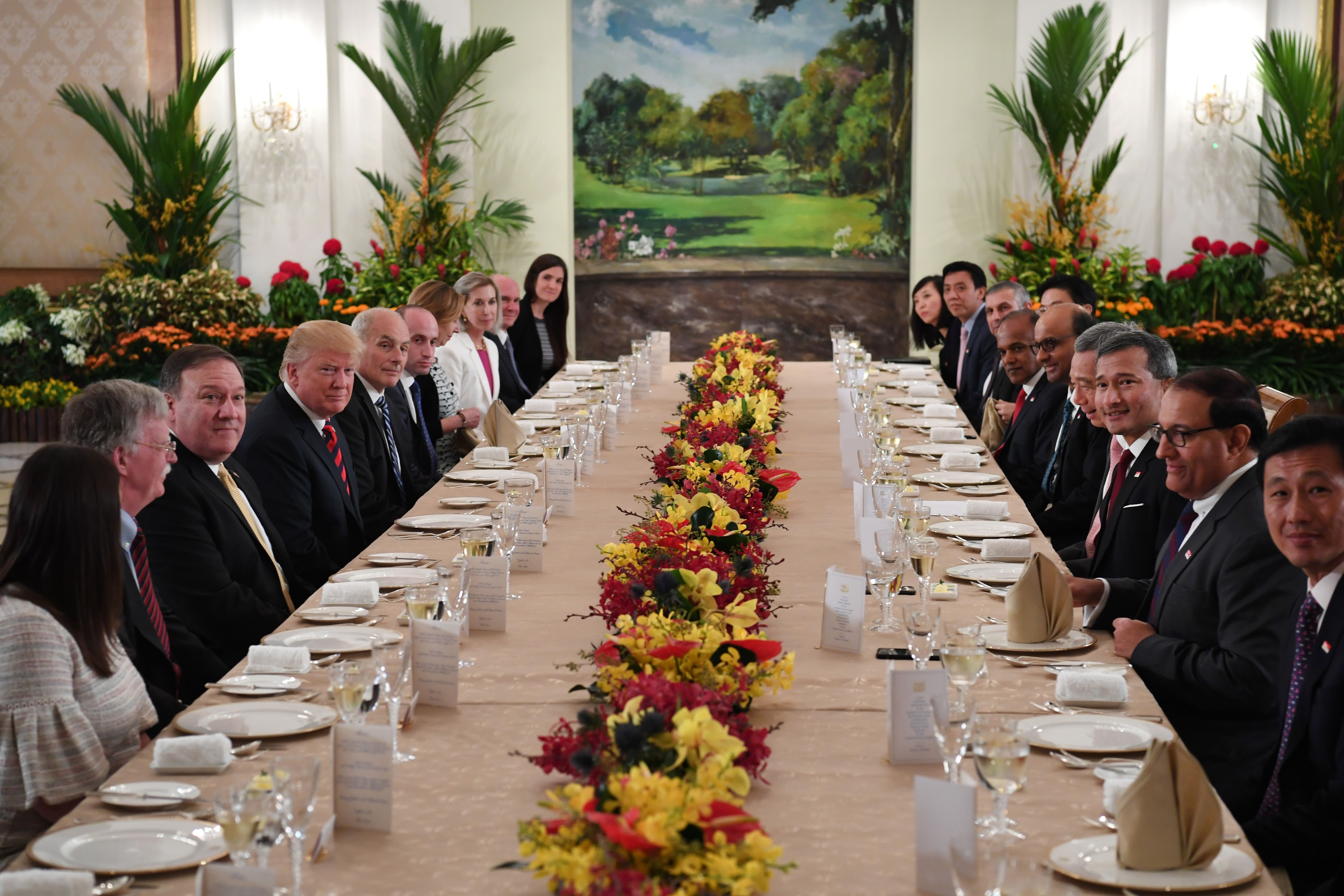 President Donald Trump and his delegation share a working lunch Singapore's Prime Minister Lee Hsien Loong (4th R) and his team during the U.S. leader's visit to Singapore on June 11, 2018.