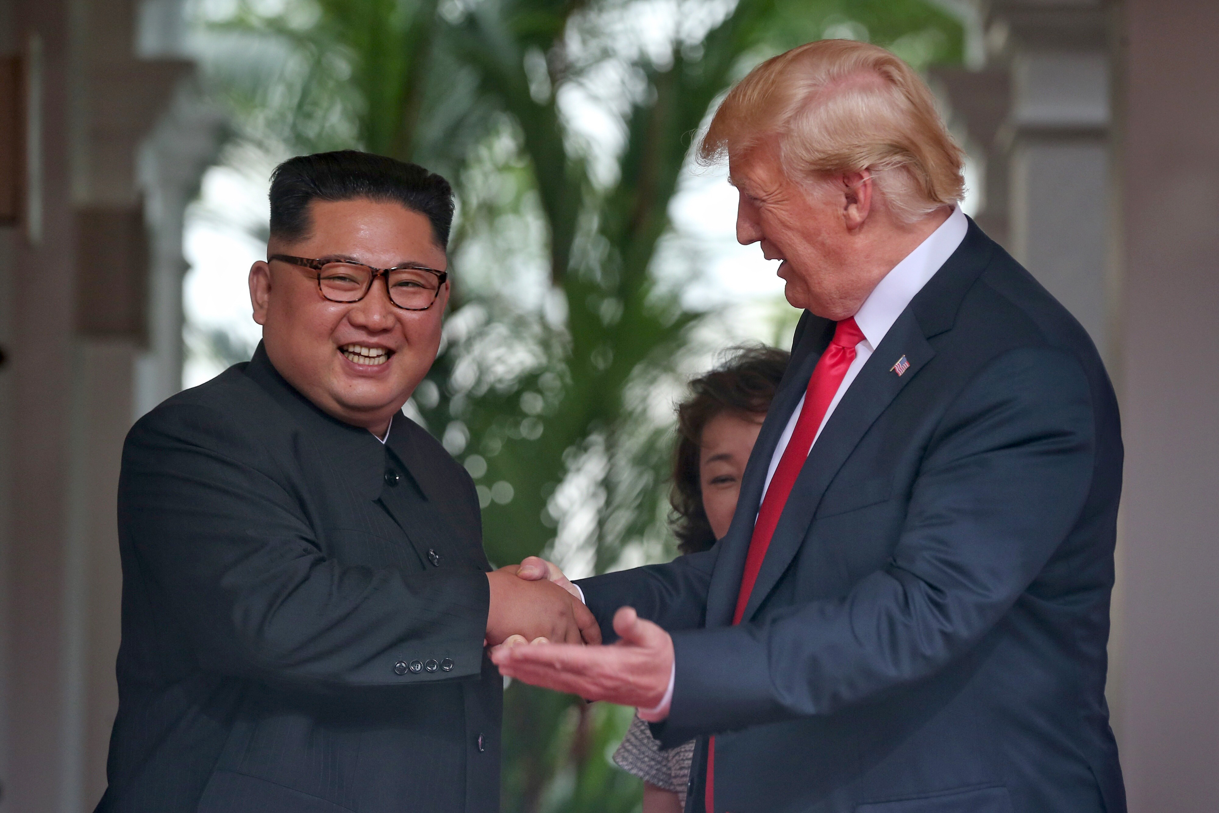North Korean leader Kim Jong-un shakes hands with U.S. President Donald Trump during their summit at the Capella Hotel on Sentosa island, Singapore on June 12, 2018.