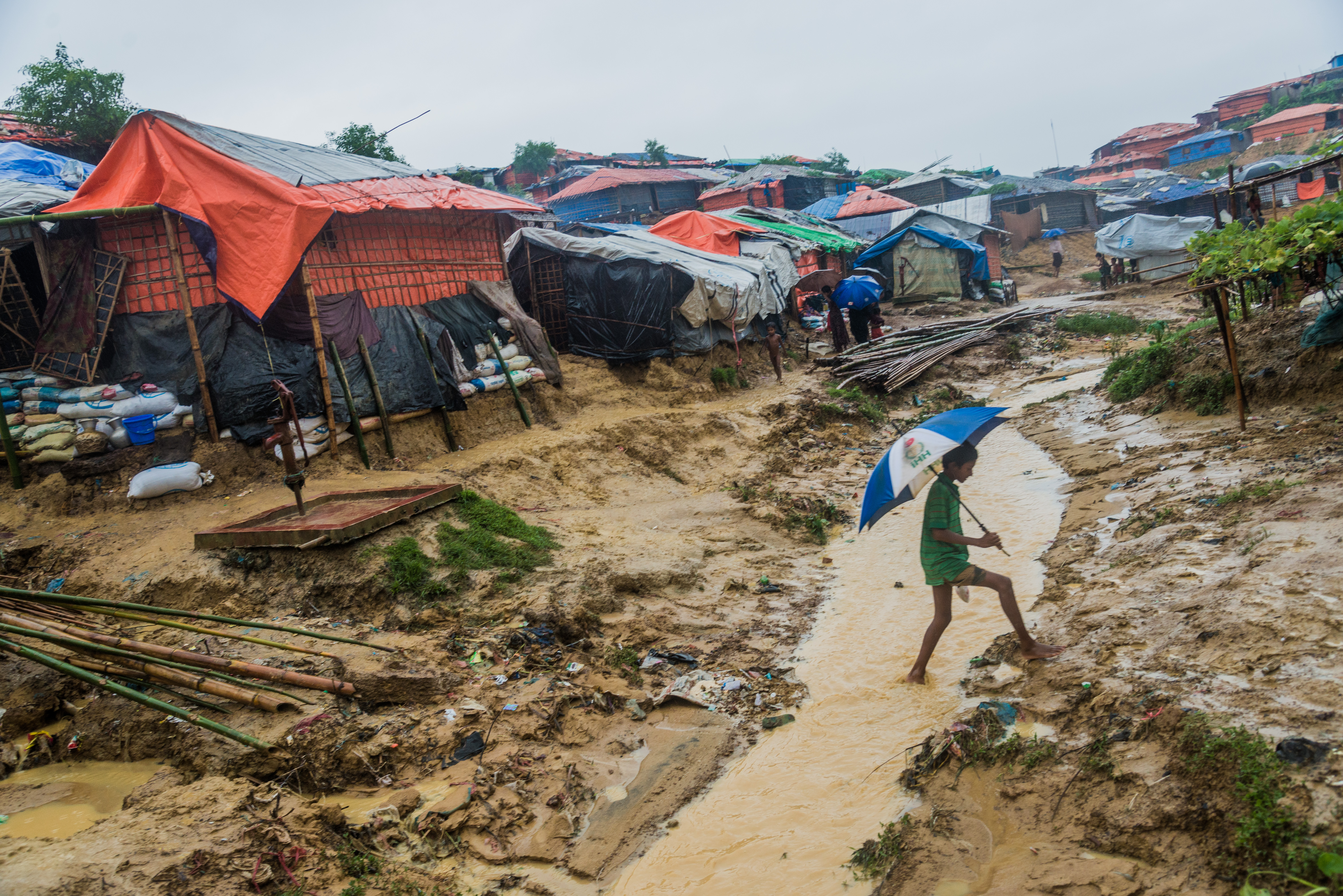 A Rohingya child walks through the Kutupalong makeshift shelter in Cox's Bazar, Bangladesh on June 13, 2018.