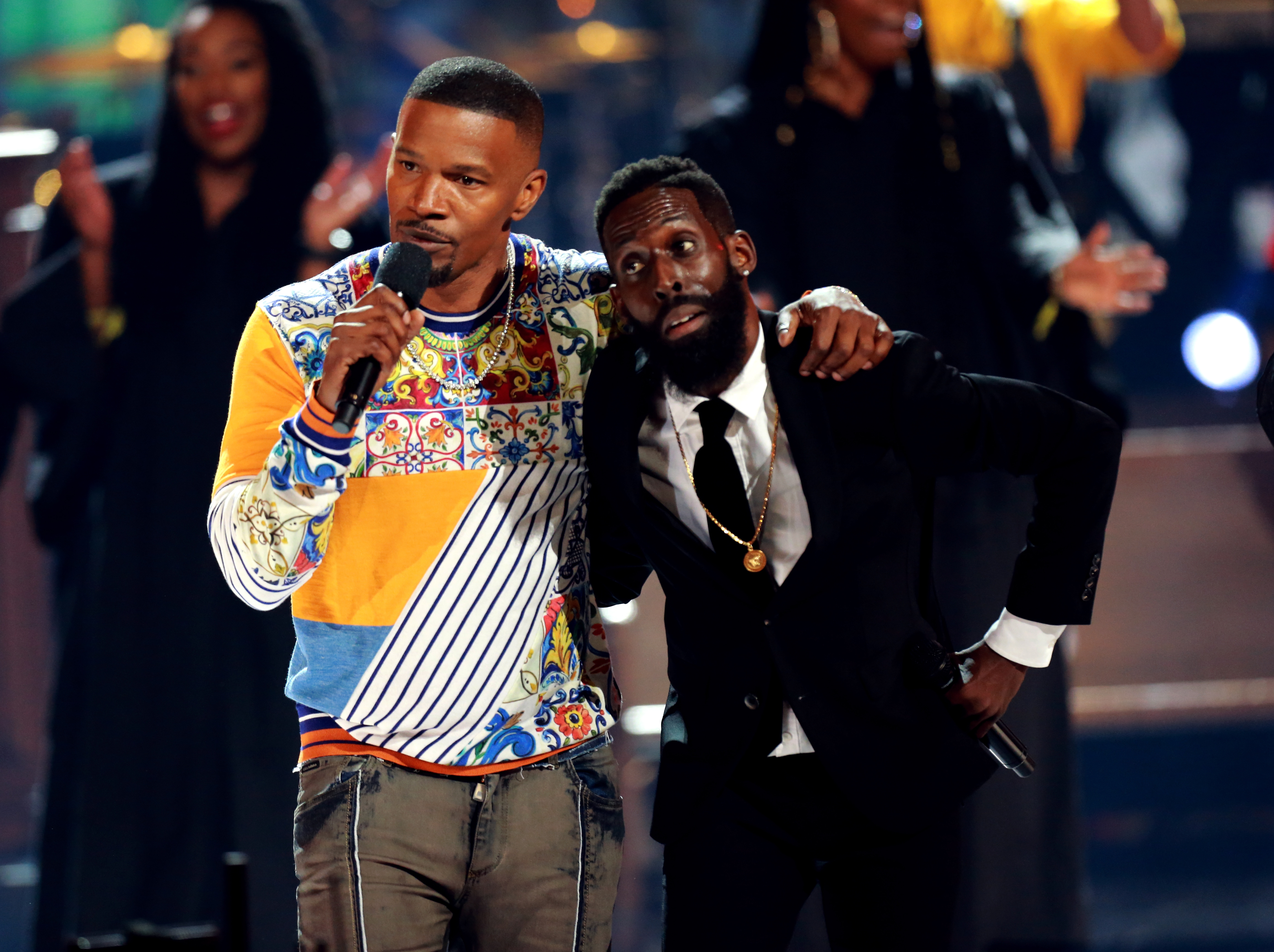 Jamie Foxx and Tye Tribbett speak onstage at the 2018 BET Awards at Microsoft Theater in Los Angeles, Calif. on June 24, 2018.