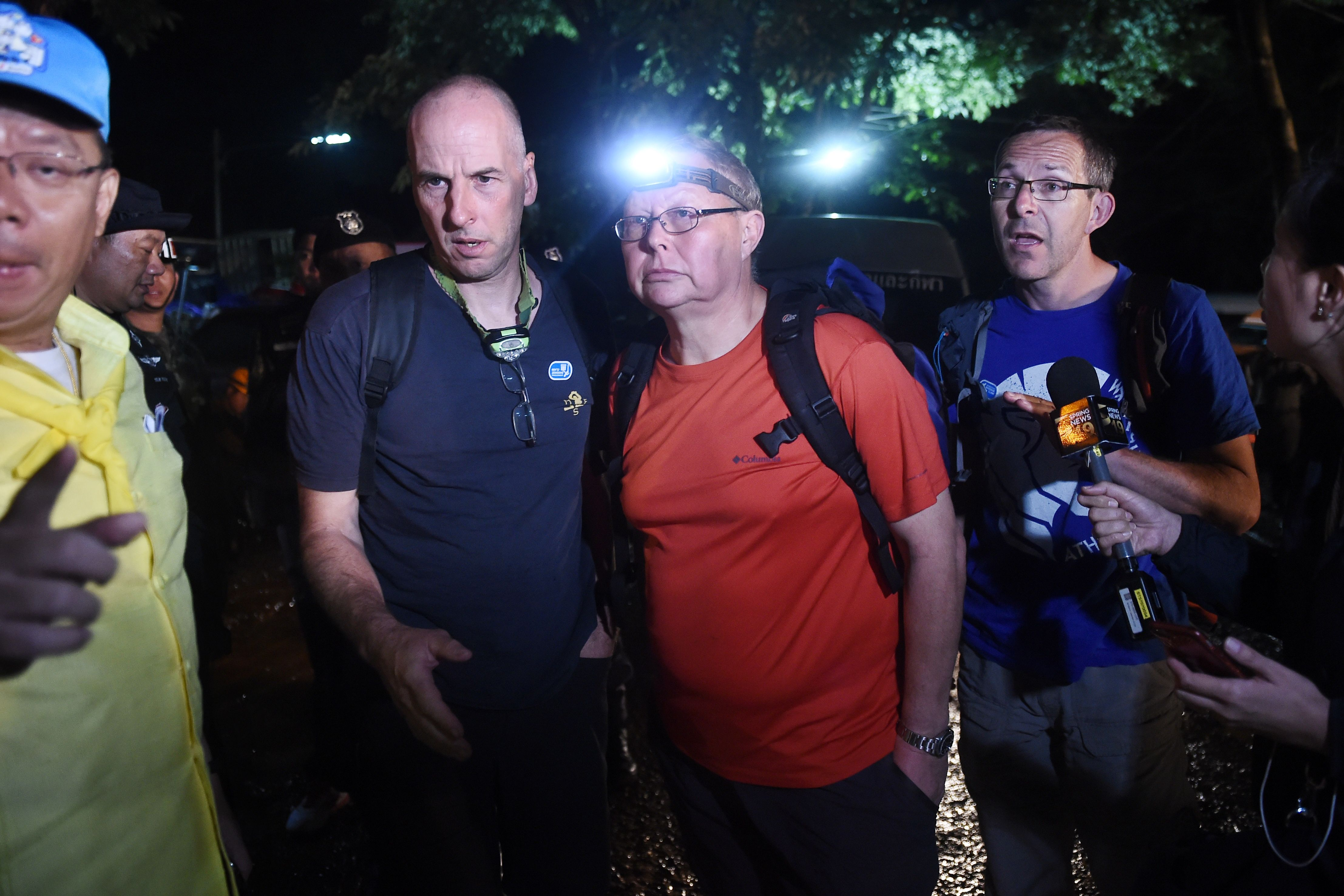 Three British cave-divers, Richard William Stanton (2nd-L), Robert Charles Harper (3rd-L) and John Volanthen (R) near the Tham Luang cave in Chiang Rai on June 27, 2018.