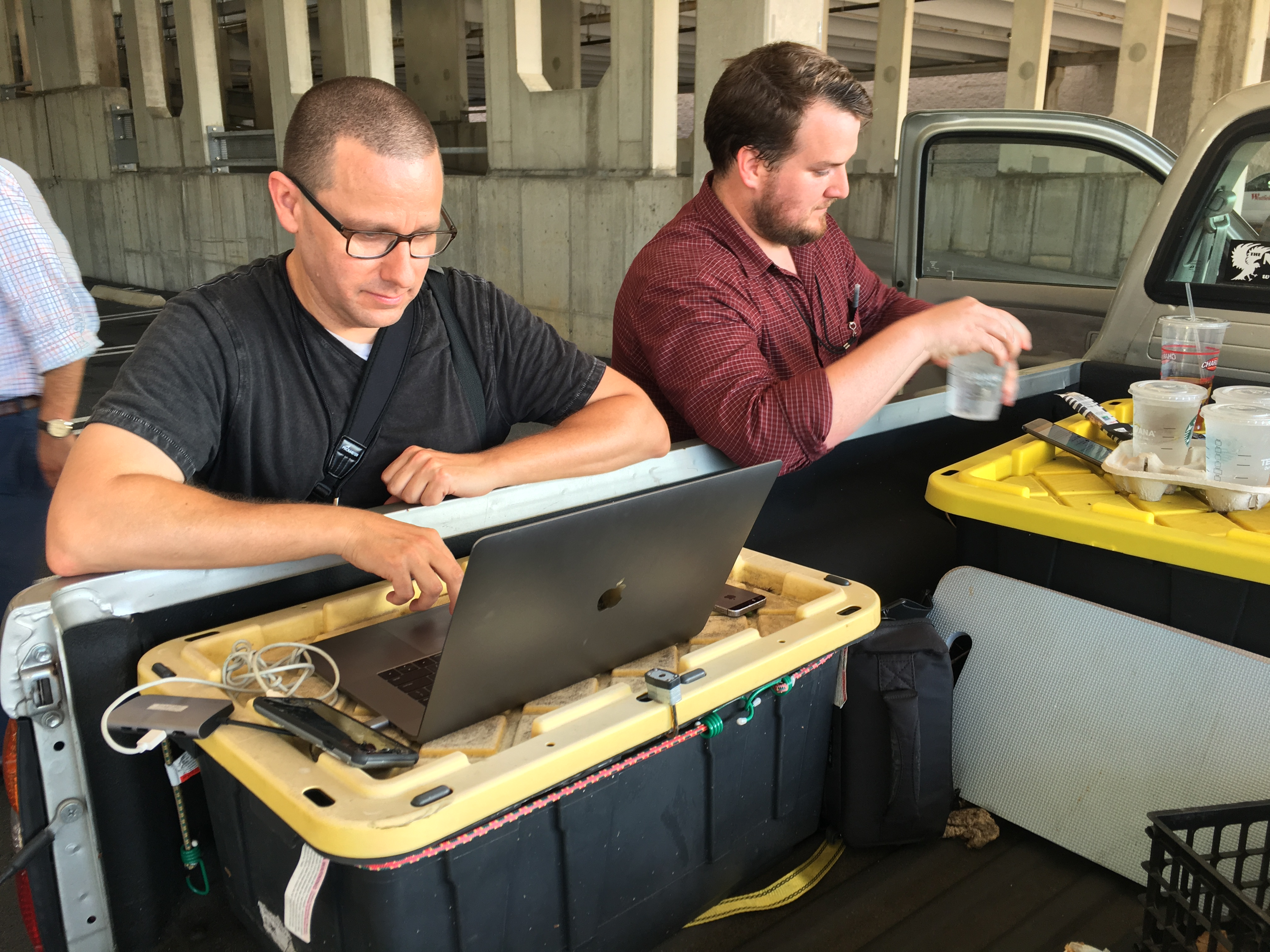 Capital Gazette reporter Chase Cook (R) and photographer Joshua McKerrow (L) work on the next days newspaper while awaiting news from their colleagues in Annapolis, Maryland, June 28, 2018.