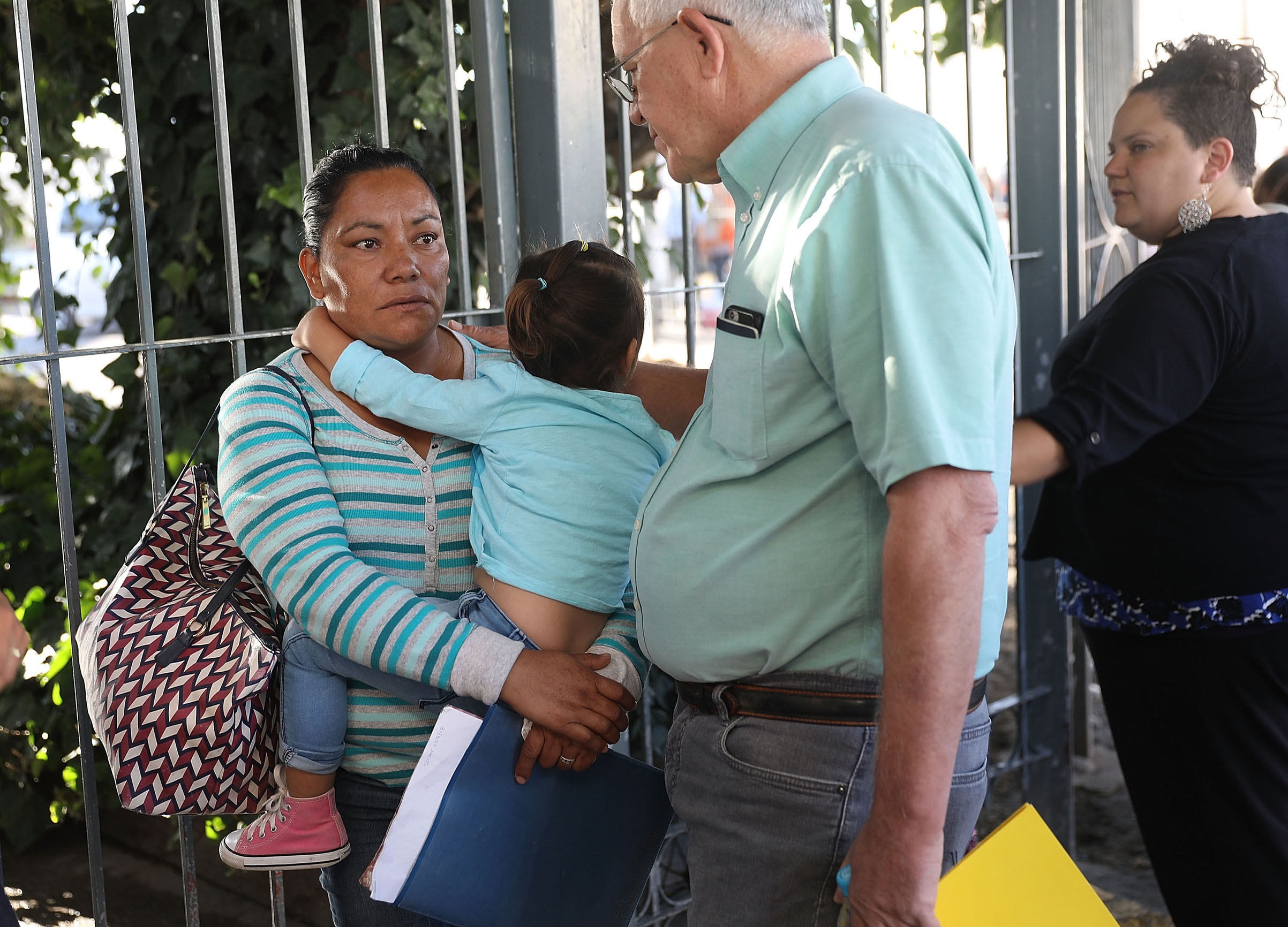 Ruben Garcia, director of the Annunciation House, speaks with Karla (who didn't want her last name used) before he helps her cross the Paso Del Norte Port of Entry to ask for asylum for herself and her grandchild in the United States on June 20, 2018 in Ciudad Juarez, Mexico. The Trump Administration's controversial zero tolerance immigration policy has led to an increase in the number of migrant children who have been separated from their families at the southern U.S. border. U.S. Attorney General Jeff Sessions has added that domestic and gang violence in immigrants' country of origin would no longer qualify them for political asylum status.