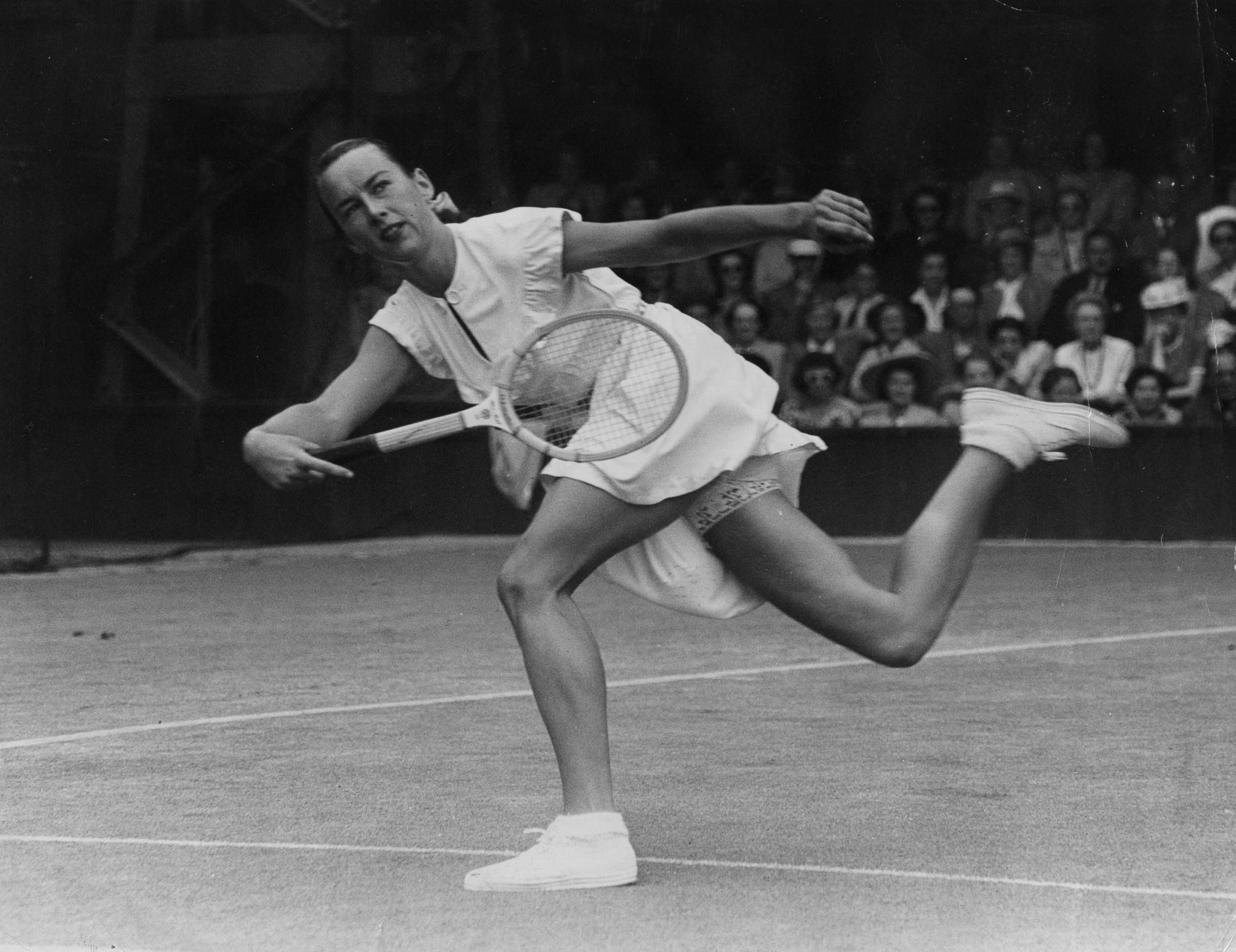 American tennis player Gertrude Moran, or Gorgeous Gussie, in action on her way to beating F M Wilford at Wimbledon on June 22, 1949.
