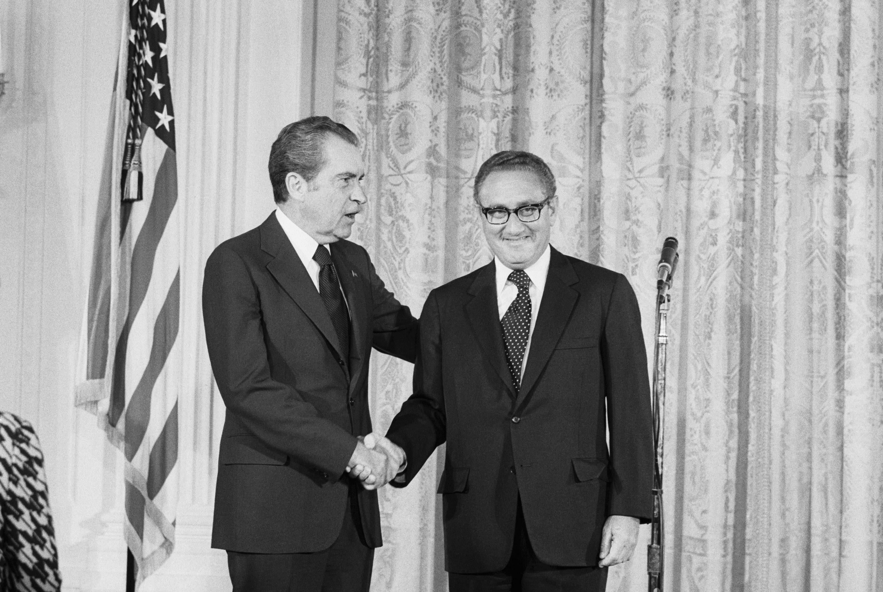 Pres. Nixon congratulates Henry Kissinger after he was sworn in as Secretary of State in a ceremony in the East Room of the White House.