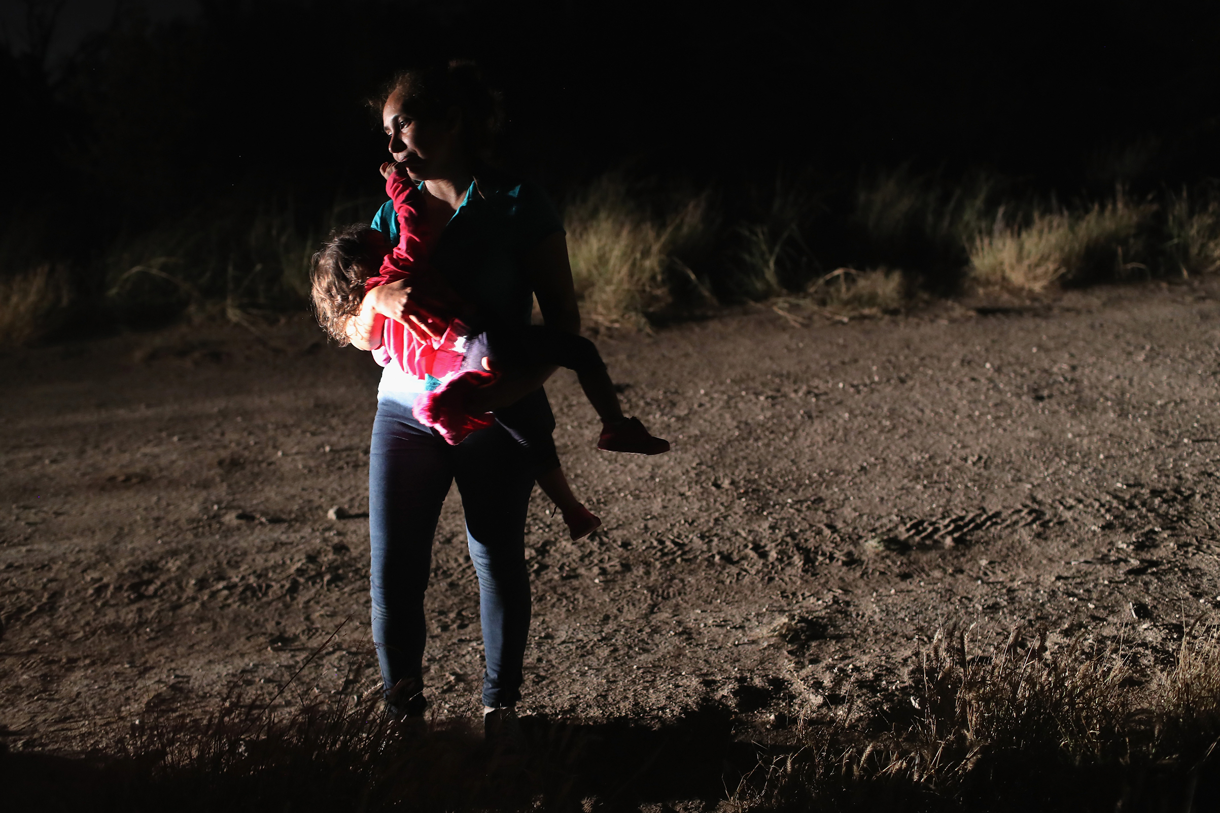 A Honduran mother holds her two-year-old daughter while being detained by U.S. Border Patrol agents near the U.S.-Mexico border on June 12, 2018 in McAllen, Texas. The asylum seekers were detained before being sent to a processing center for possible separation. Customs and Border Protection (CBP) is executing the Trump administration's  zero tolerance  policy towards undocumented immigrants.