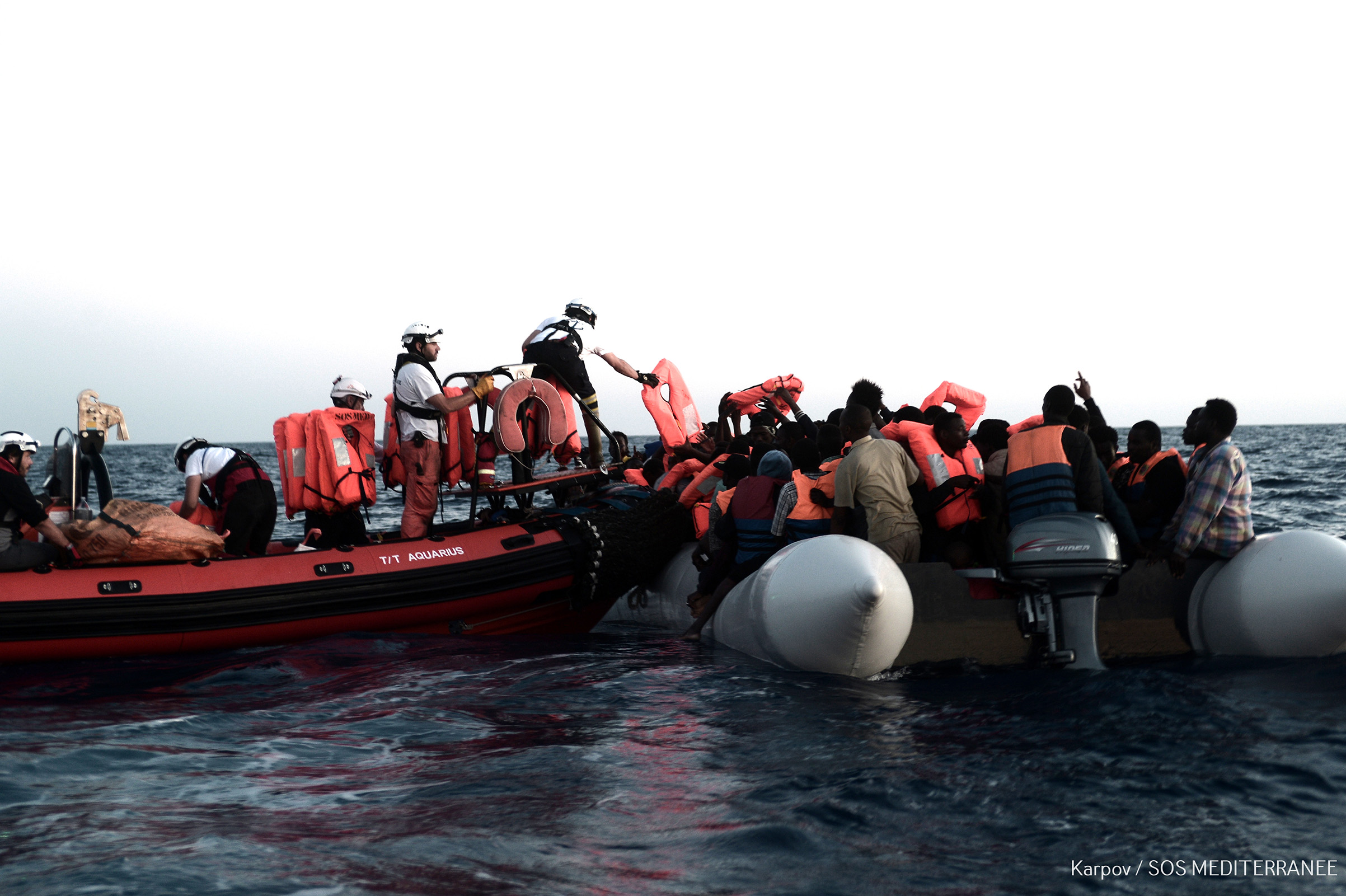 A handout photo made available by the NGO 'SOS Mediterranee' on 11 June shows the sea rescue of a total of 629 migrants in the Mediterranean, June 9 2018. The rescue vessel 'Aquarius', carrying a total of 629 migrants rescued off the Libyan coast, was denied access to ports in Italy and Malta in a diplomatic row between the two countries.