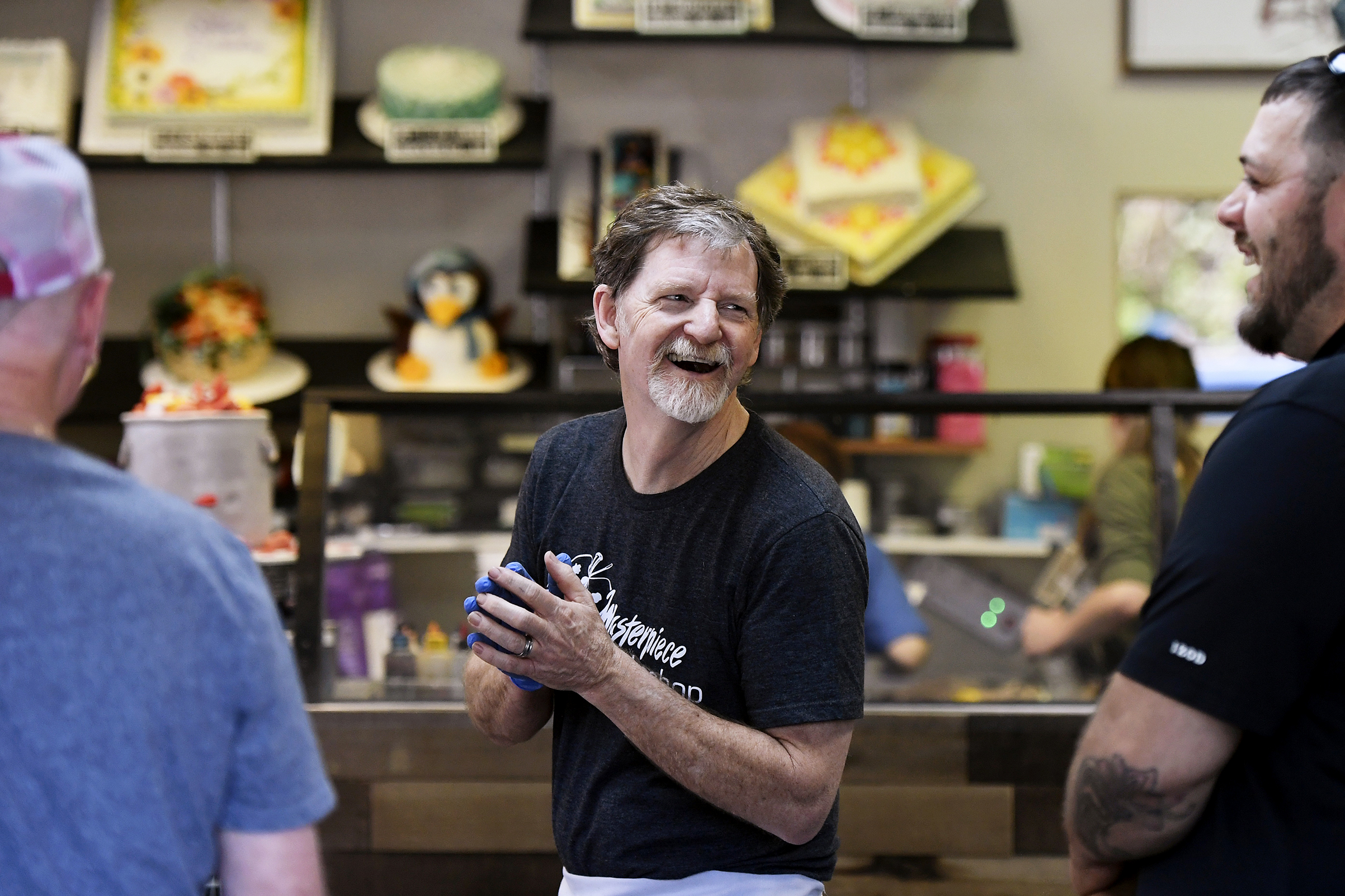 Phillips, at his bakery, smiling after the decision