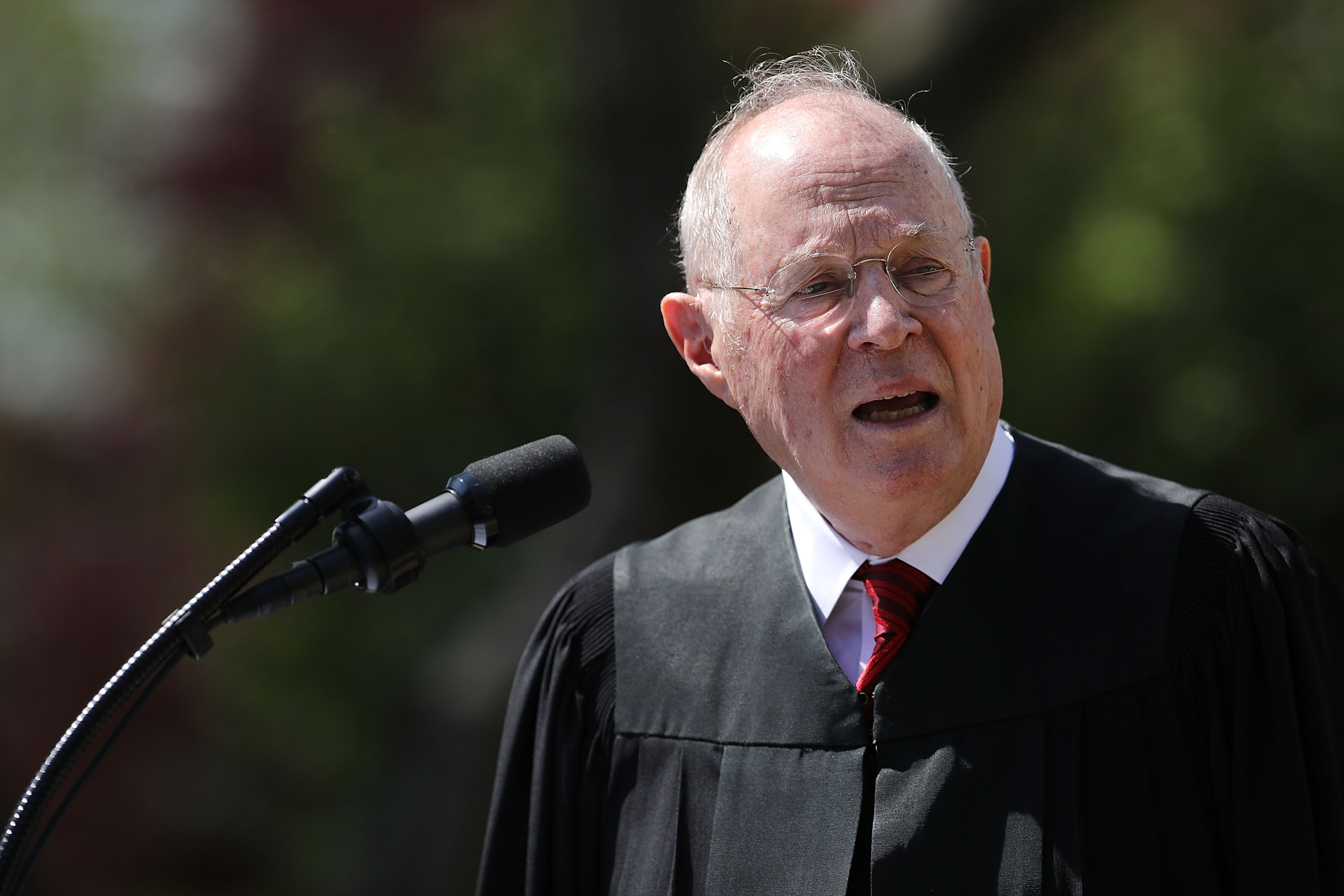 Supreme Court Associate Justice Anthony Kennedy delivers remarks before administering the judicial oath to Judge Neil Gorsuch during a ceremony in the Rose Garden at the White House on April 10, 2017.