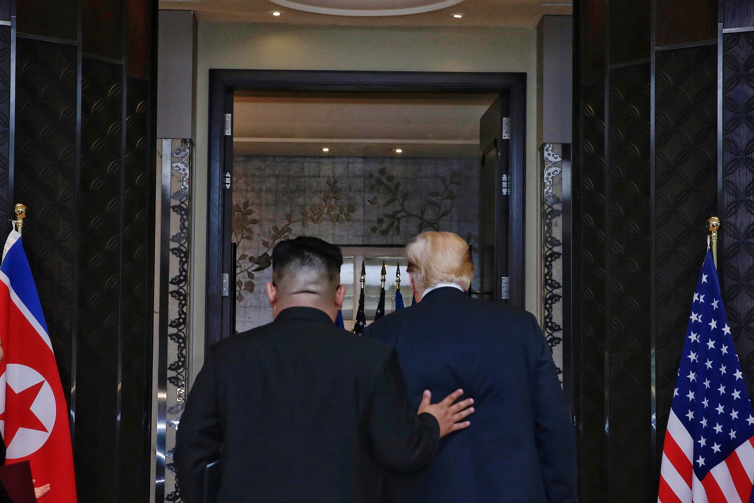 Kim and Trump depart the signingceremony at the end of their meeting in Singapore on June 12