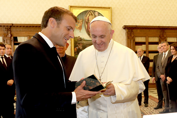 Pope Francis exchanges gifts with French President Emmanuel Macron during an audience at the Apostolic Palace on June 26, 2018 in Vatican City, Vatican.