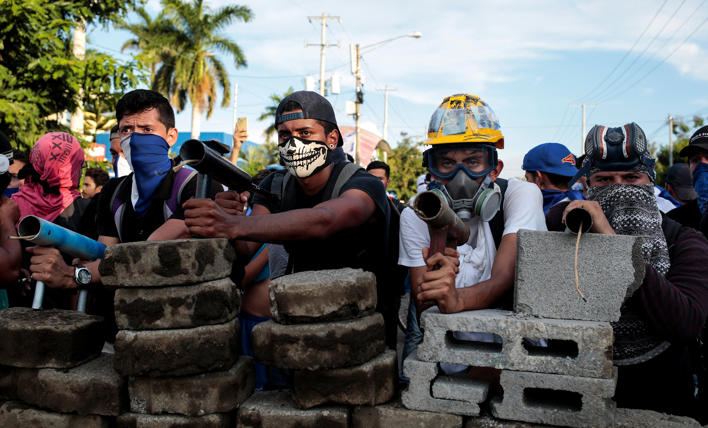Demonstrators behind a barricade at an antigovernment protest in Managua on May 30