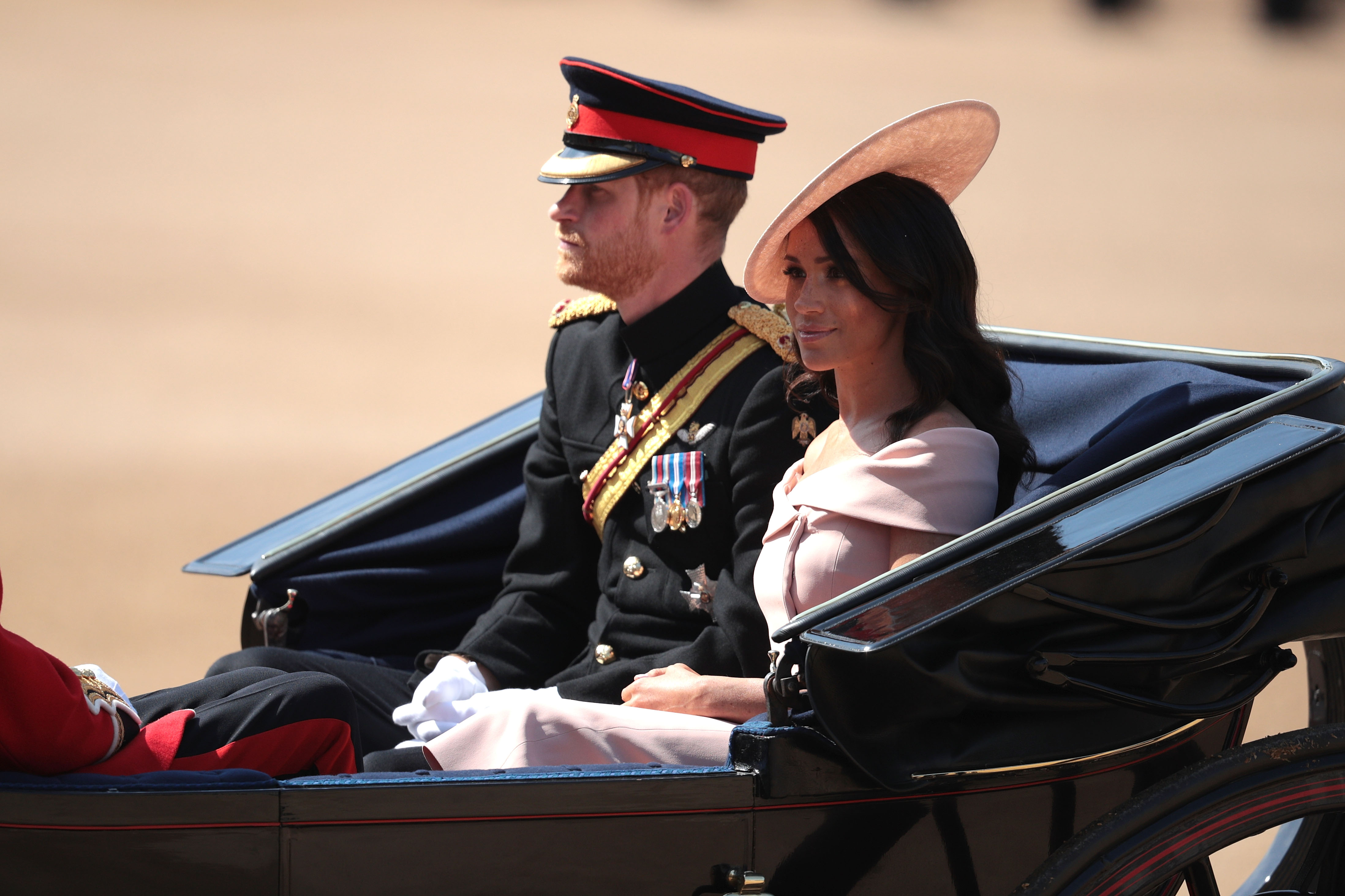 Prince Harry, Duke of Sussex, and Meghan Markle, Duchess of Sussex, arrive at The Royal Horseguards during Trooping the Colour ceremony on June 9, 2018 in London, England