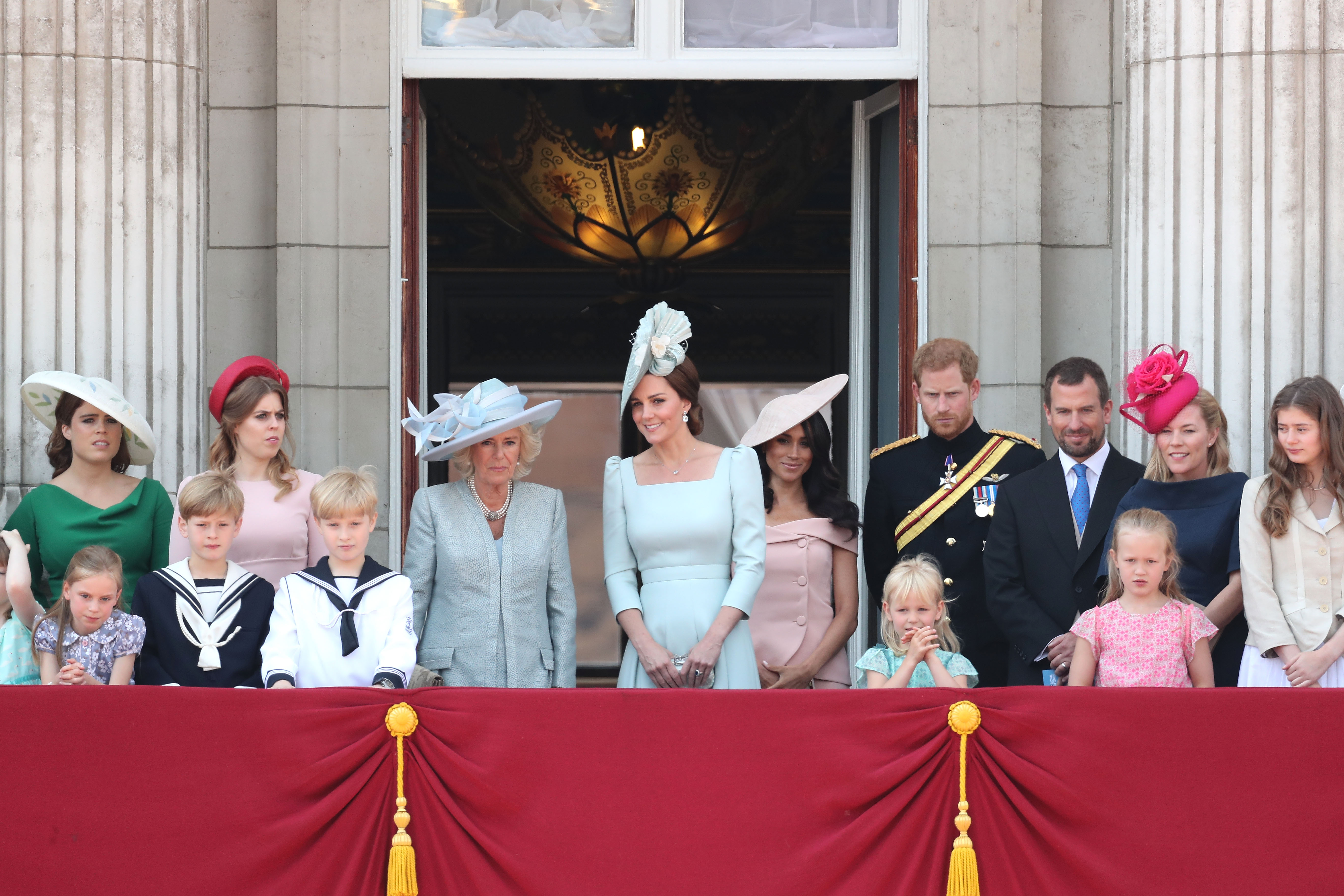(From left to right) Princess Eugenie, Princess Beatrice, Camilla, Duchess Of Cornwall, Kate Middleton, Duchess of Cambridge, Meghan Markle, Duchess of Sussex, Prince Harry, Duke of Sussex. (Front row, left to right) Peter Phillips, Autumn Phillips, Isla Phillips and Savannah Phillips on the balcony of Buckingham Palace during Trooping The Colour on June 9, 2018 in London, England