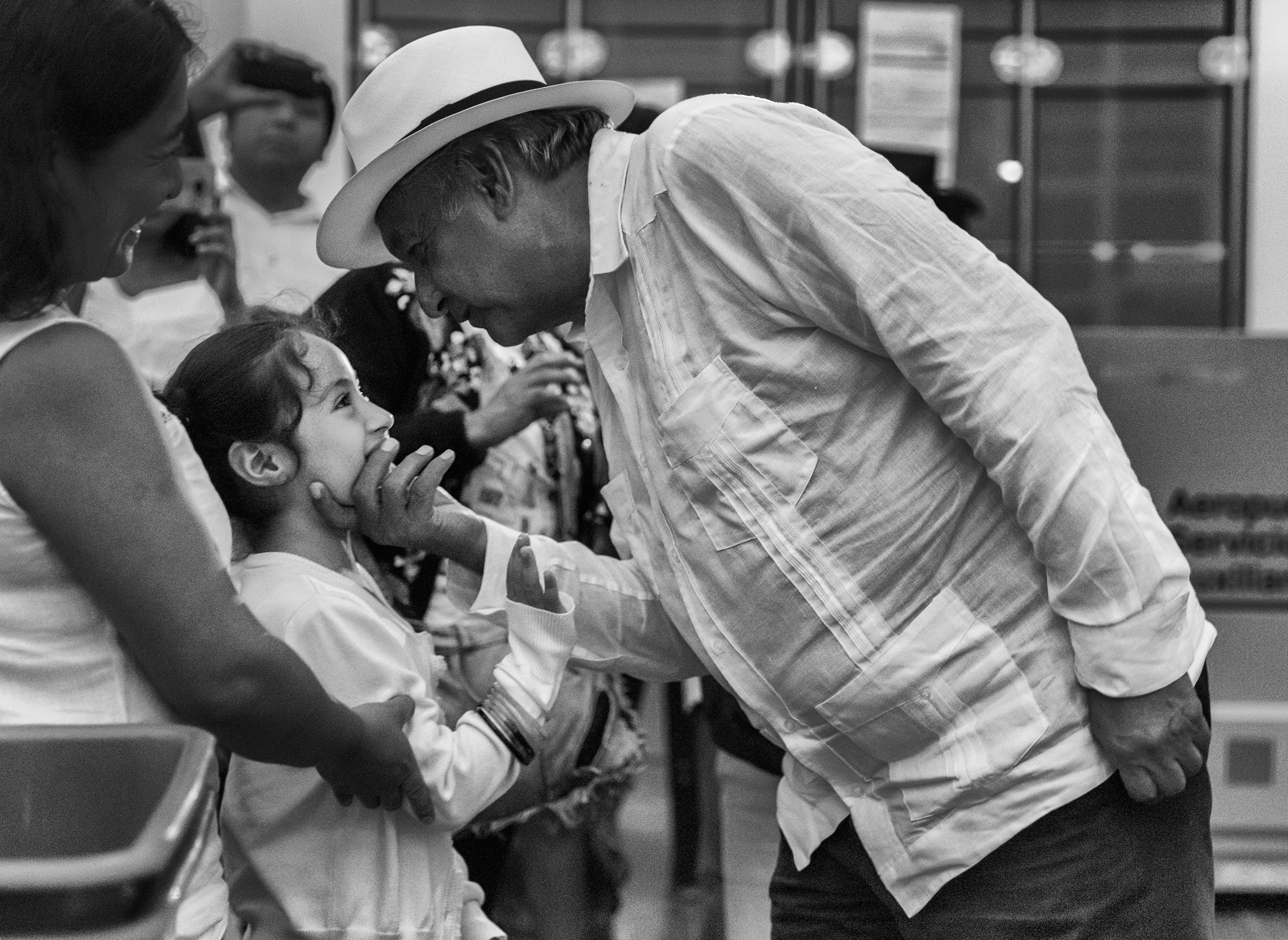 López Obrador greets a young girl in a departures lounge at the airport in Campeche, following a campaign rally, on June 26. He made three final stops on the Yucatán Peninsula before heading back to Mexico City.