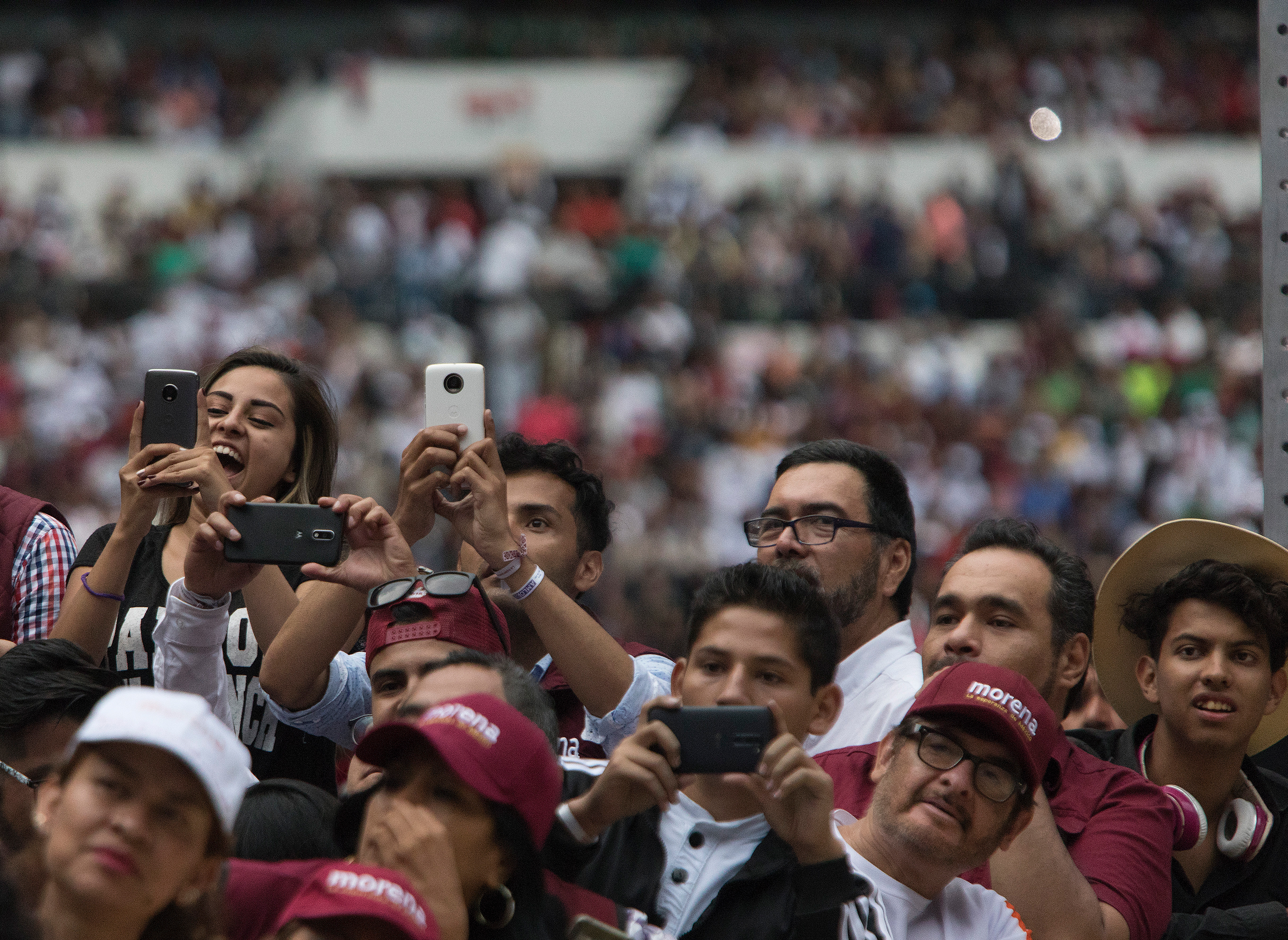 Supporters hold up their mobile phones during a musical performance at López Obrador's final campaign rally at Estadio Azetca in Mexico City on June 27.