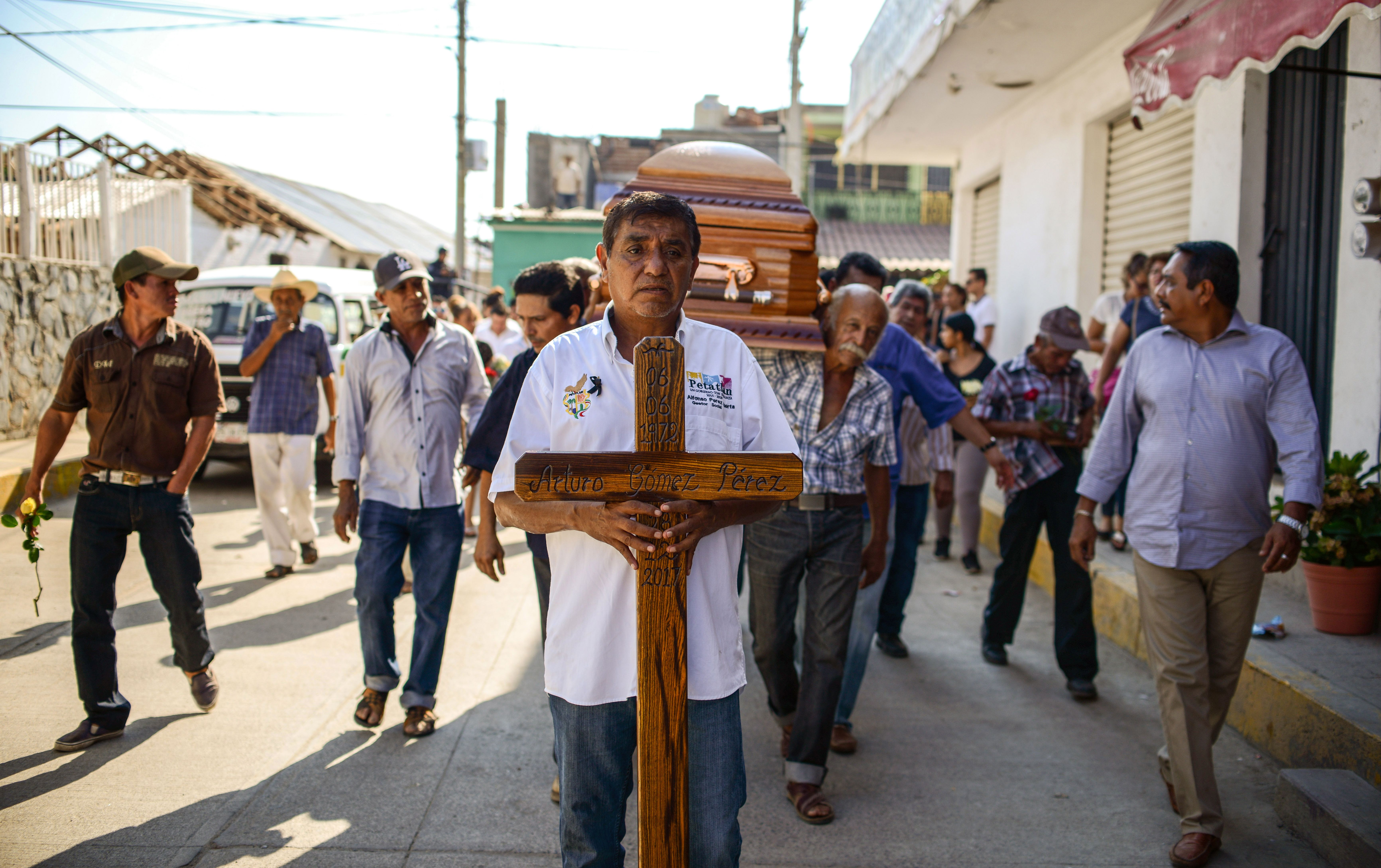 Relatives and friends of the mayor of the Mexican community of Petatlan, Arturo Gomez, carry his coffin during his funeral in Petatlan, Guerrero State, on December 29, 2017 a day after he was shot dead while dining at a restaurant.                     An armed group killed mayor Gomez in the convulsed state of Guerrero in southern Mexico, according to the security spokesman for the Guerrero government Roberto Alvarez.