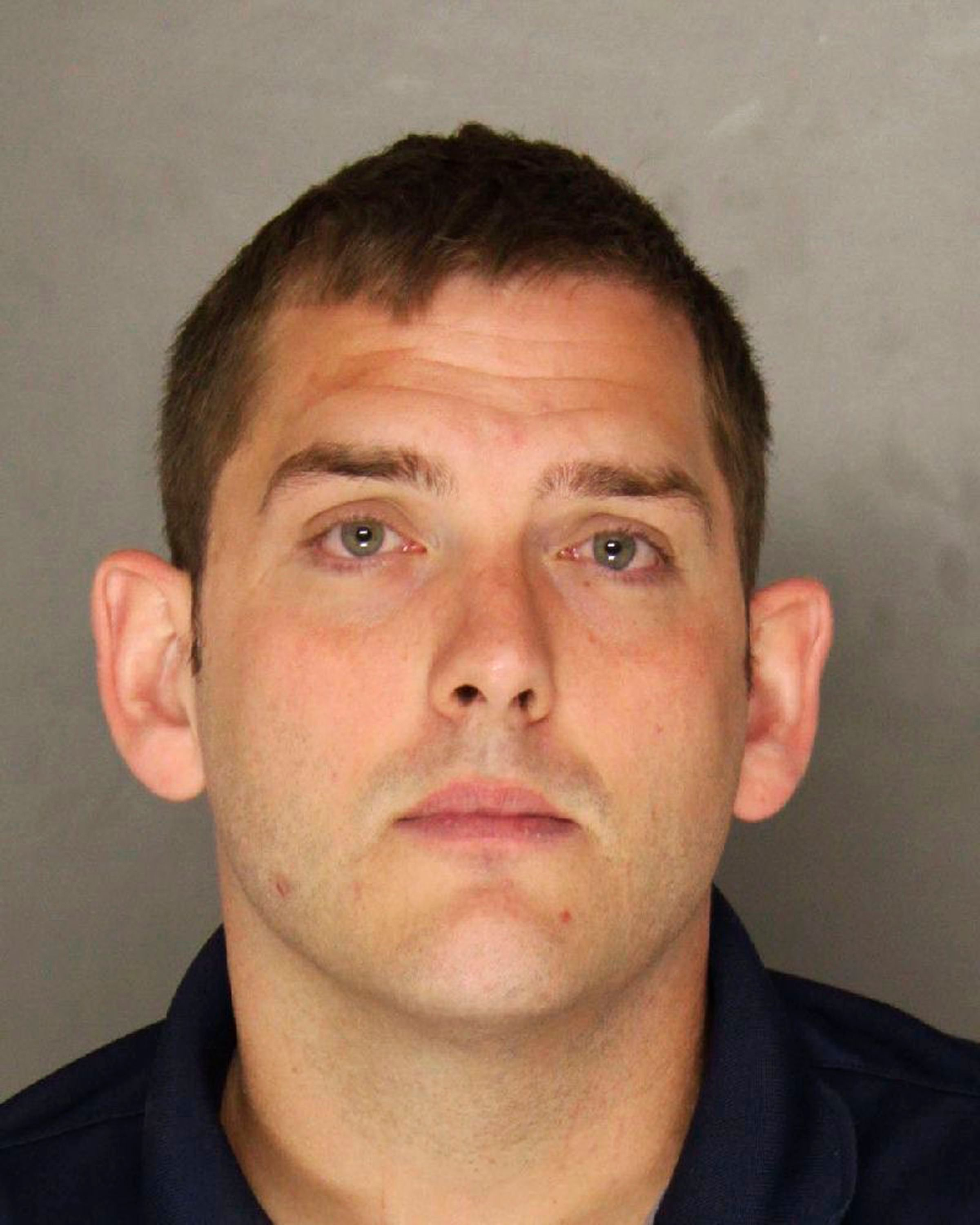 This undated photo provided by the Allegheny County District Attorney shows Michael Rosfeld, an East Pittsburgh, Pa., police officer. Rosfeld was charged with homicide, in the shooting death of Antwon Rose Jr. after a traffic stop June 19 in East Pittsburgh