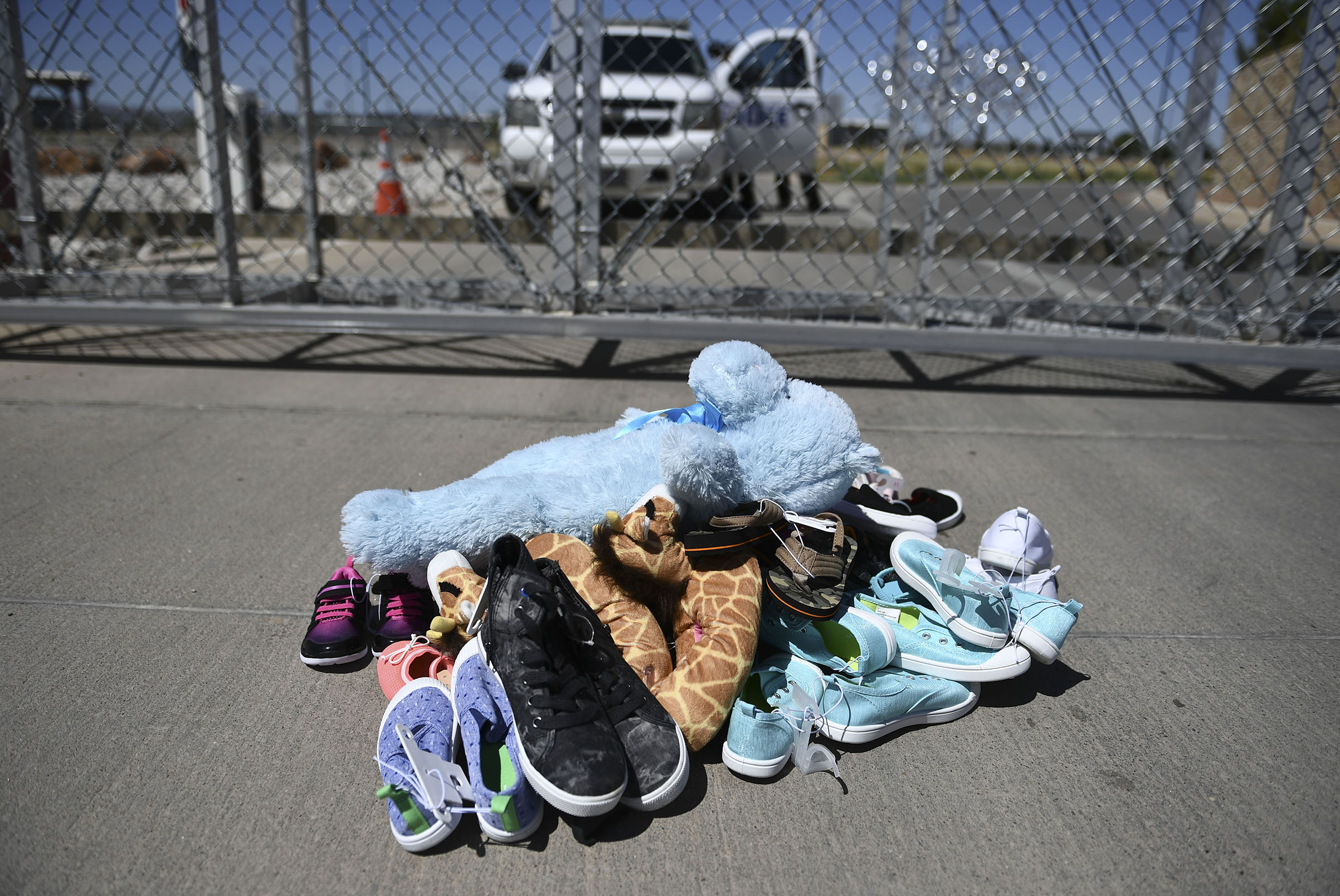 Shoes and toys for immigrant children are left at the Tornillo Port of Entry near El Paso, Texas, June 21, 2018.
