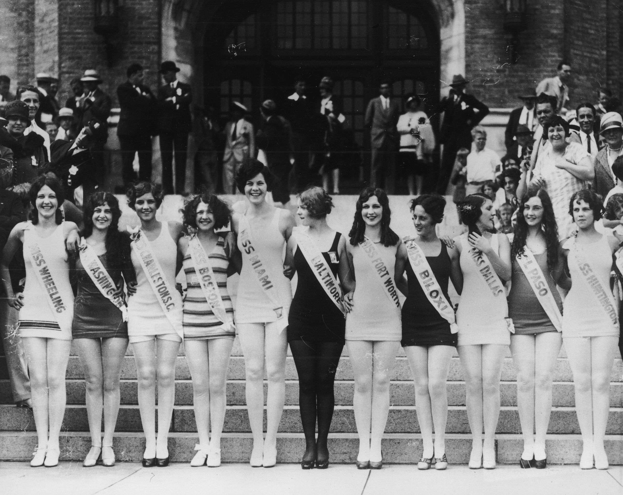 1927: Contestants in the 'Miss America' pageant pose in a line, with their arms around each other, Atlantic City, N.J.