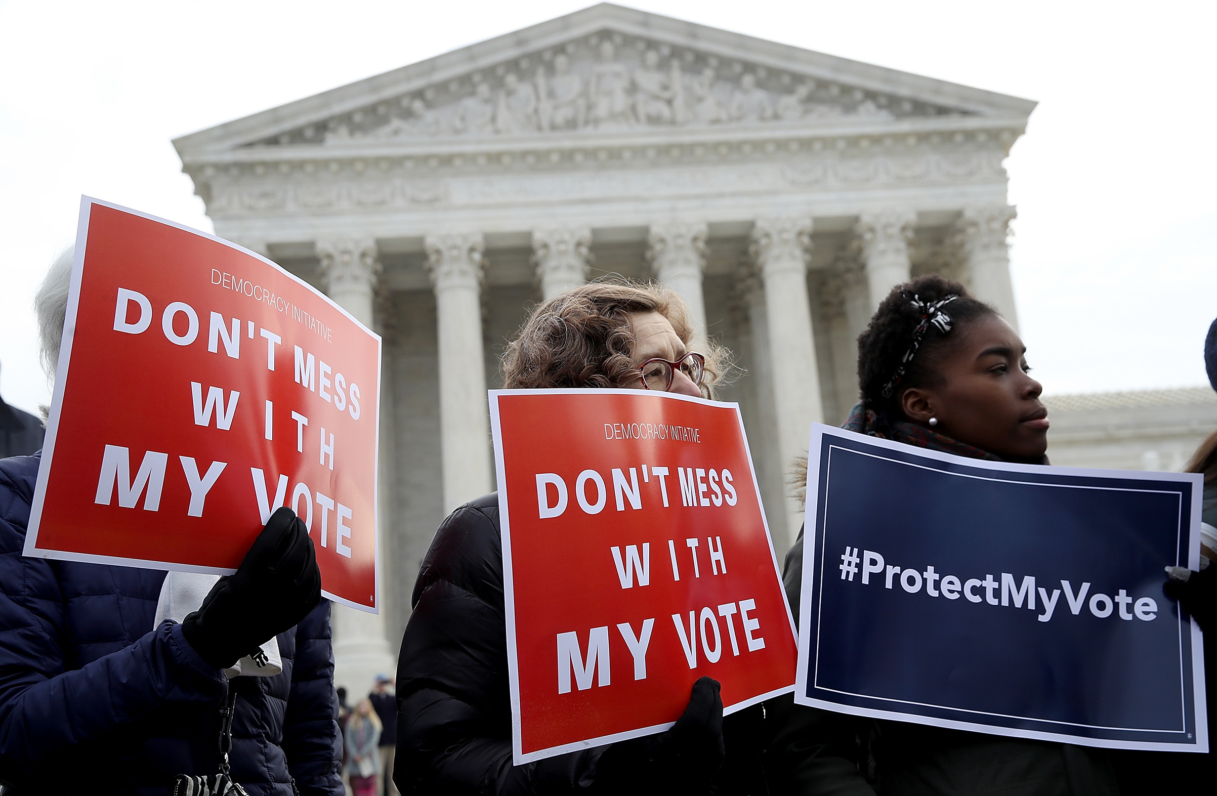 Protesters gather during a rally held by the group Common Cause in front of the U.S. Supreme Court January 10, 2018 in Washington, DC. Voting rights activists rallied to oppose voter roll purges as the Supreme Court hears oral arguments in the Husted v. A Philip Randolph Institute, a challenge to Ohio's voter roll purges.