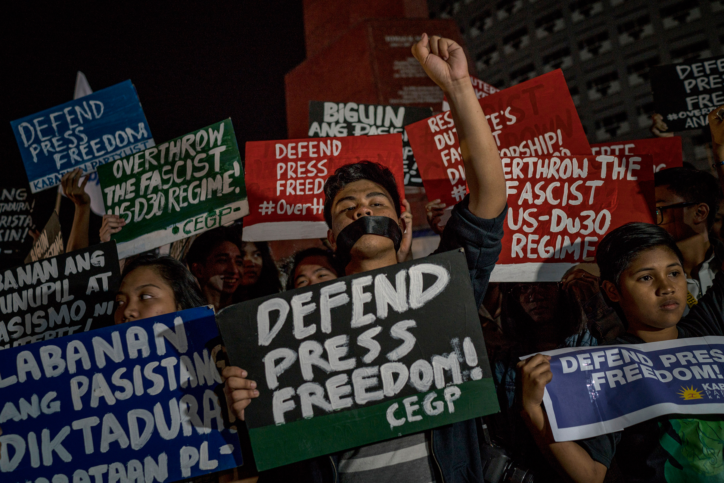Journalists and activists stage a protest calling to defend press freedom in suburban Quezon City, in Metro Manila, Philippines, on Jan 19, 2018.