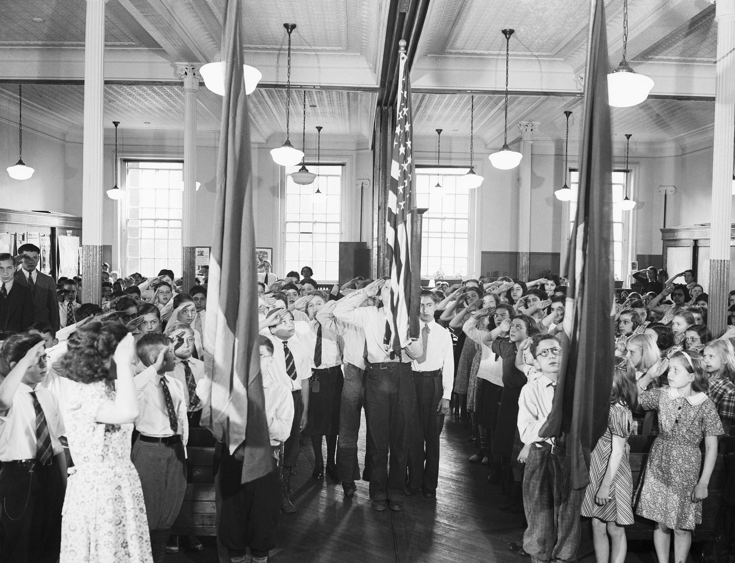 Students at P.S. #73 reciting the 'Pledge of Allegiance' on Jun. 1, 1938, in New York, N.Y.