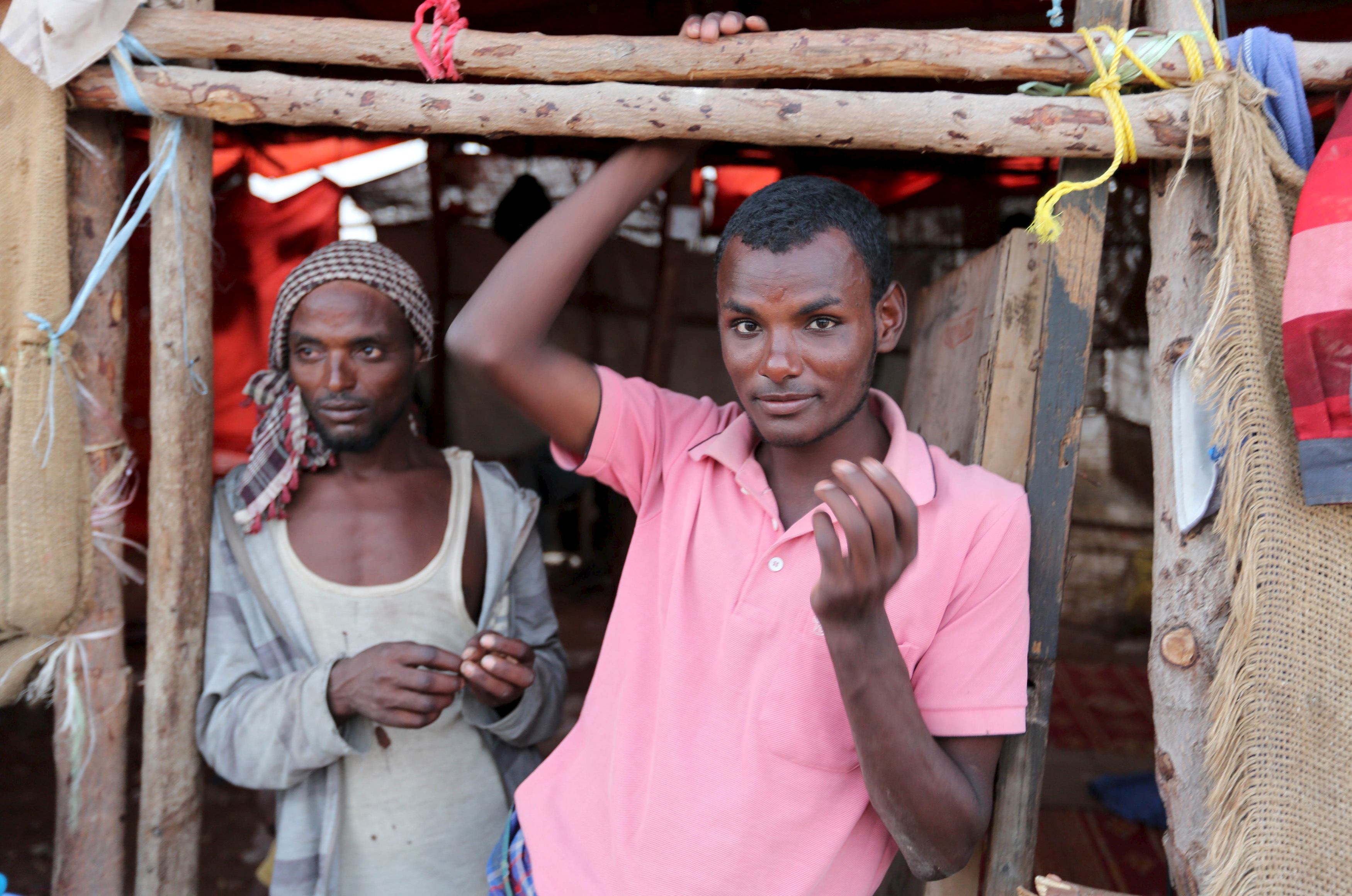 Illegal immigrants from Ethiopia attempting to cross into Yemen stand at their makeshift shelter in Bosasso, northern Somalia on April 14, 2015.