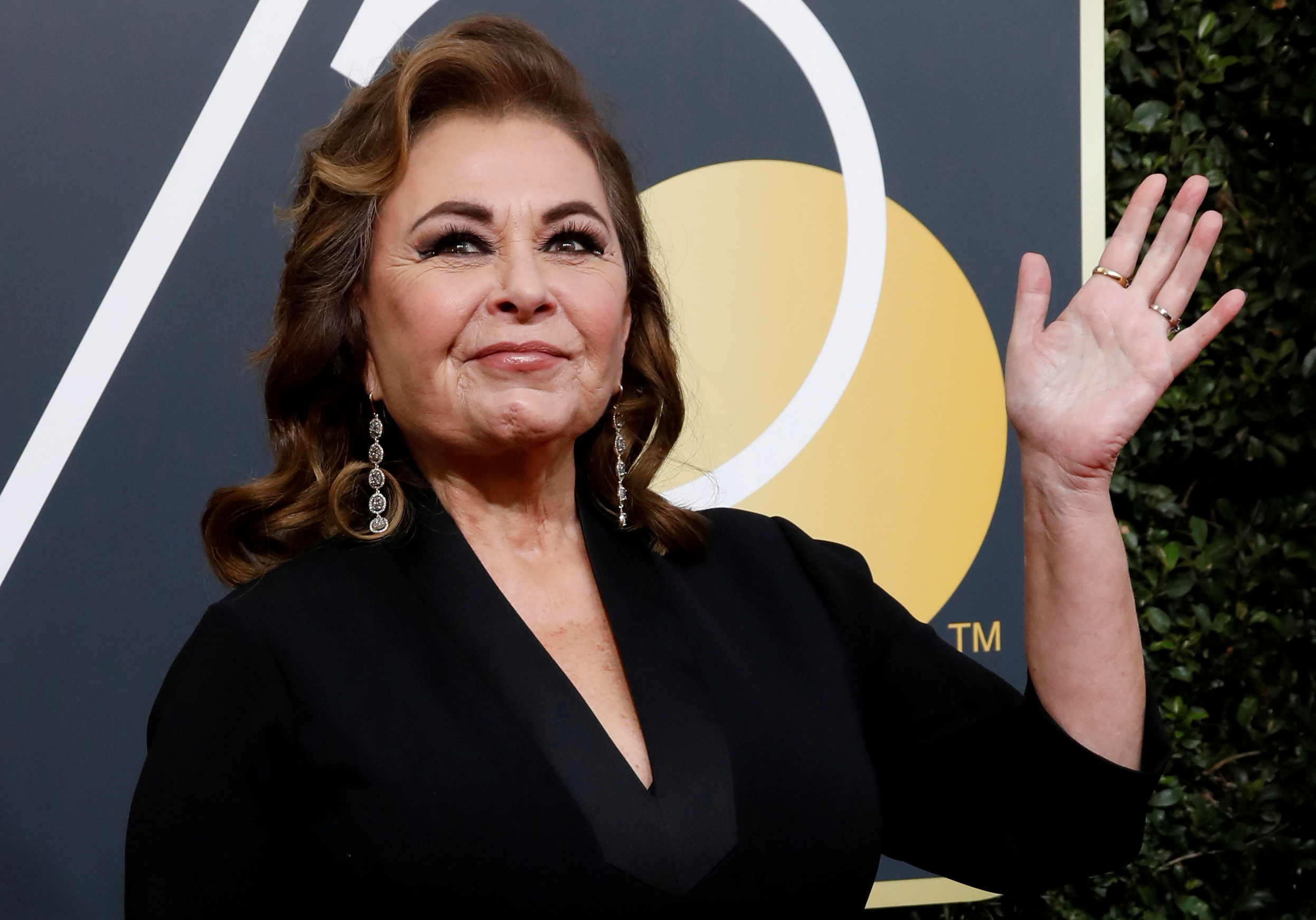 Actress Roseanne Barr waves on her arrival to the 75th Golden Globe Awards in Beverly Hills, Calif.,  on Jan. 7, 2018.