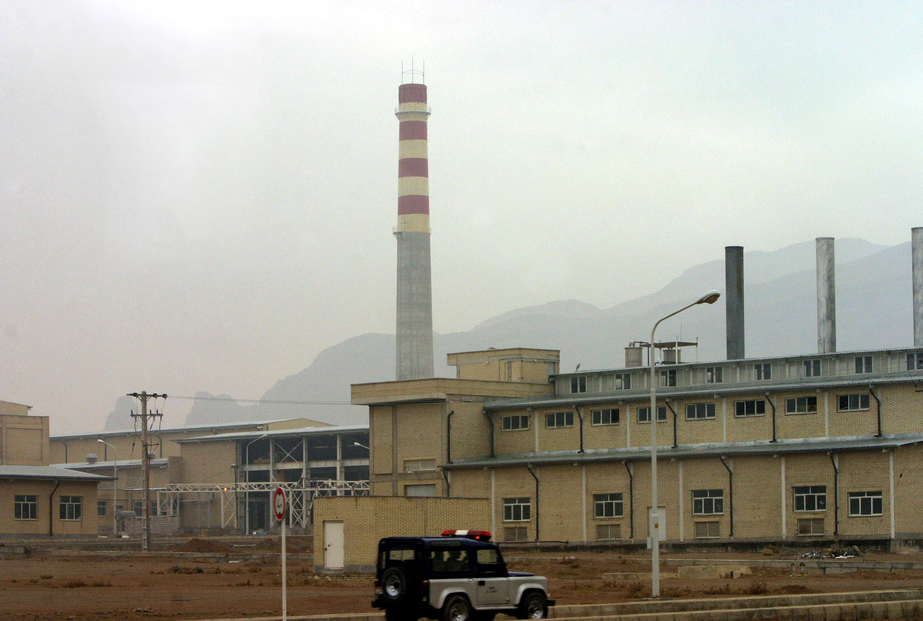 A security car passes in front of the Natanz nuclear facility, 300 km south of Tehrah, Iran on Nov. 20, 2004.