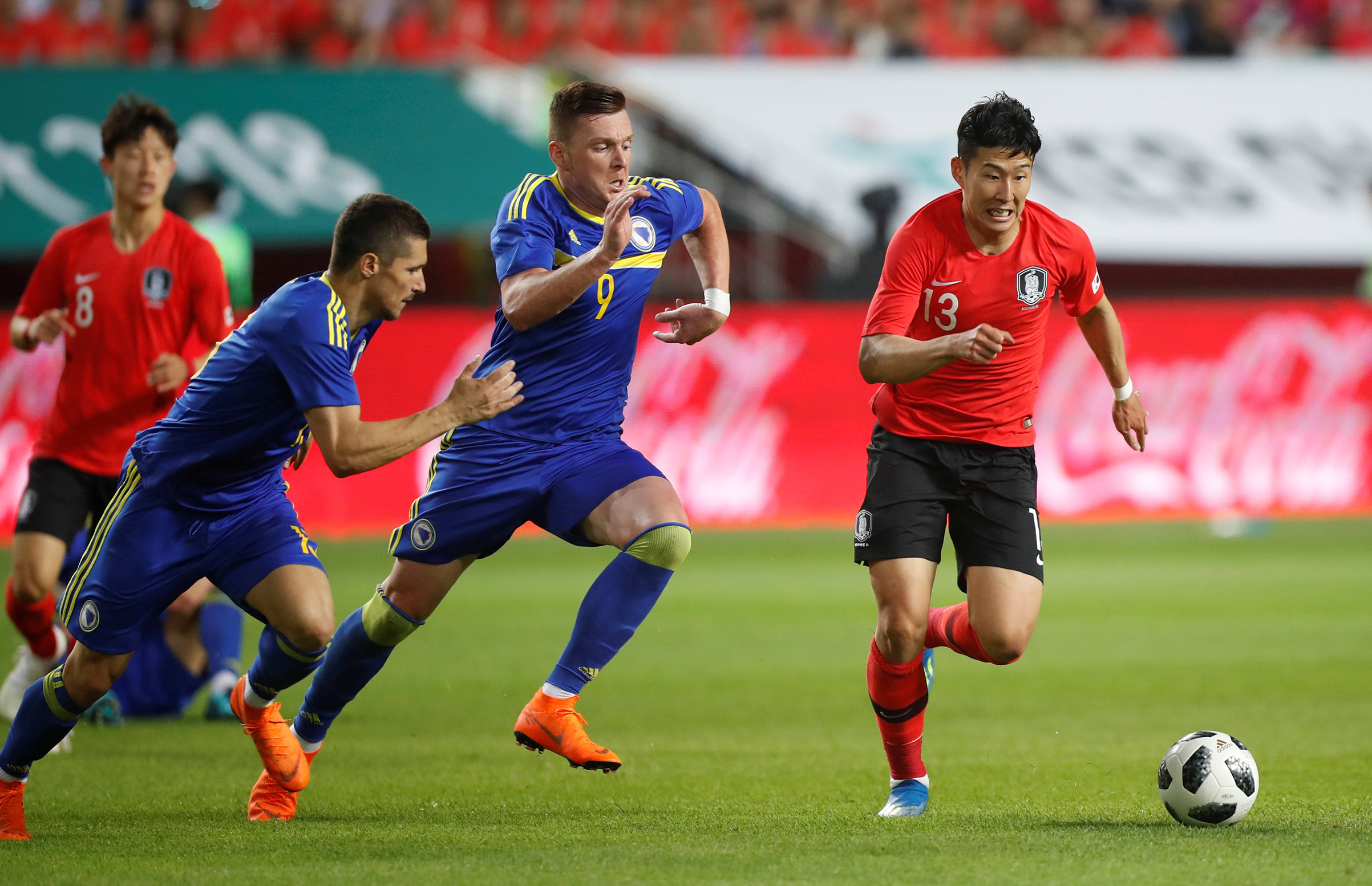 South Korea's Son Heung-Min in action with Bosnia's Haris Duljevic on June 1.