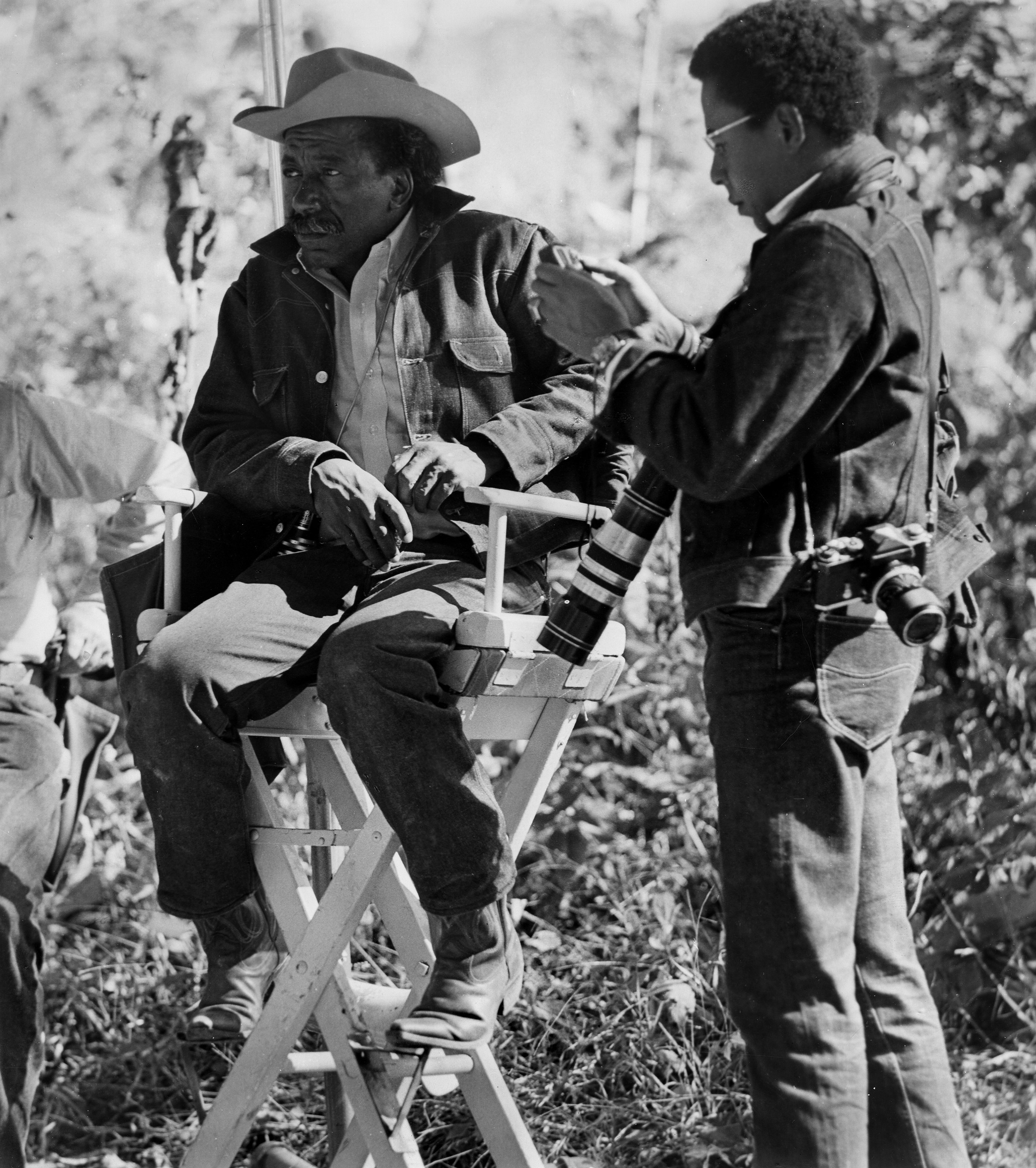 Publicity still portrait of American directors Gordon Parks Sr and his son Gordon Parks Jr on the set of the Warner Bros. film 'The Learning Tree,' circa 1969.