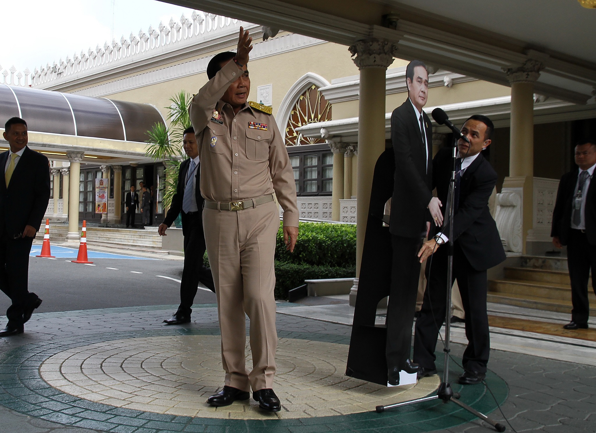 The Thai leader leaves a Jan. 8 press conference, telling reporters to direct questions to a cardboard cutout