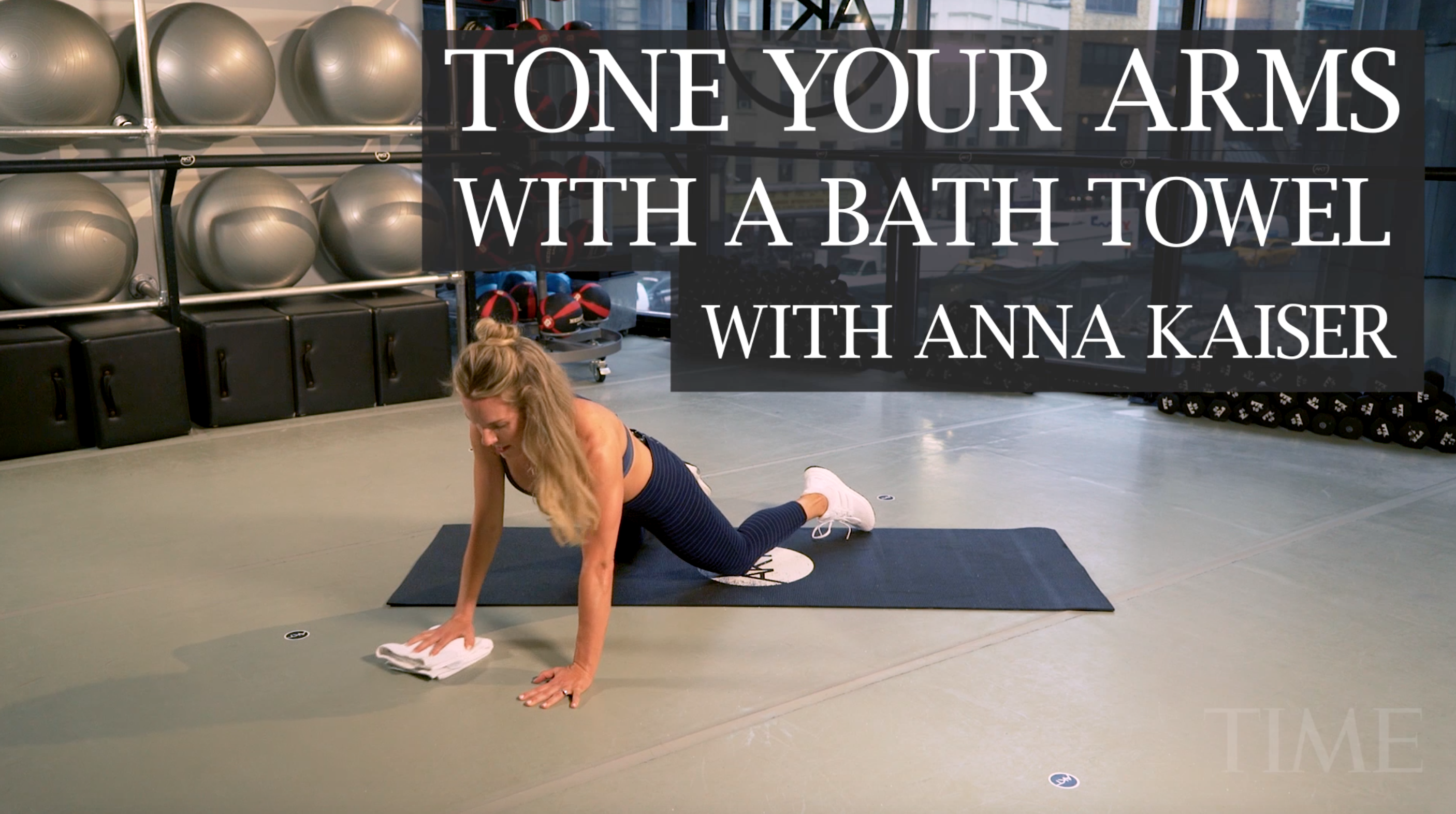 Anna Kaiser, founder of AKT in Motion, demonstrating an arm toning workout with a bath towel.