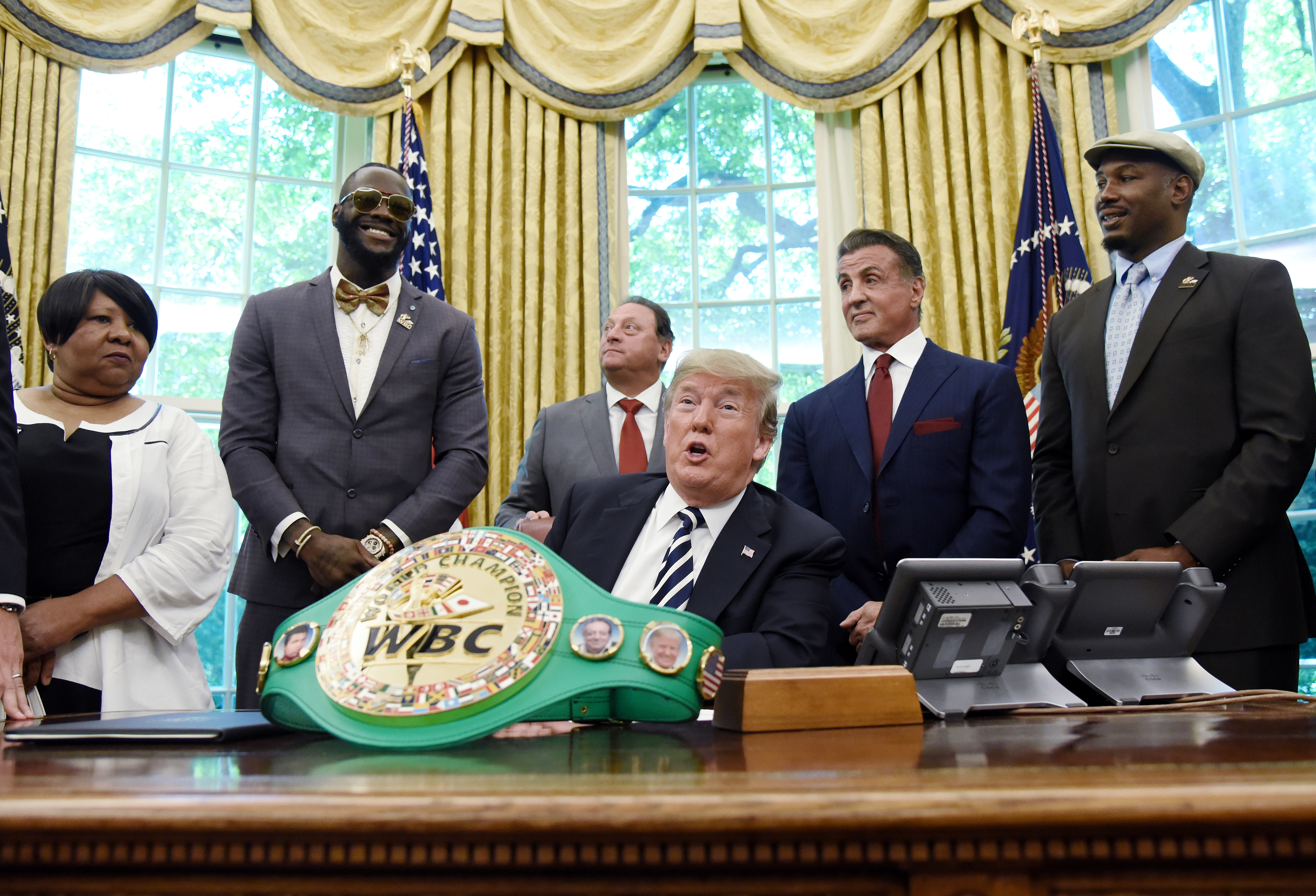 U.S. President Donald Trump speaks after signing an executive order granting a posthumouspardon for Jack Johnson, the first black heavyweight boxing champion, as boxing champion Lenox Lewis, from left, and actor Sylvester Stallone attend in the Oval Office of the White House in Washington, D.C., U.S., on Thursday, May 24, 2018.