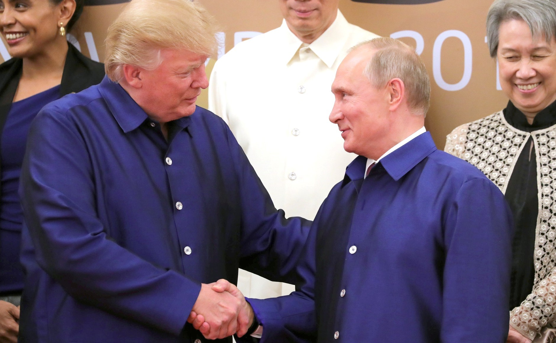 NOV 10 2017 - US President Donald Trump and Russia's President Vladimir Putin shake hands during a family photo ceremony at the 2017 Asia-Pacific Economic Cooperation (APEC) summit in Da Nang, Vietnam on November 10, 2017.