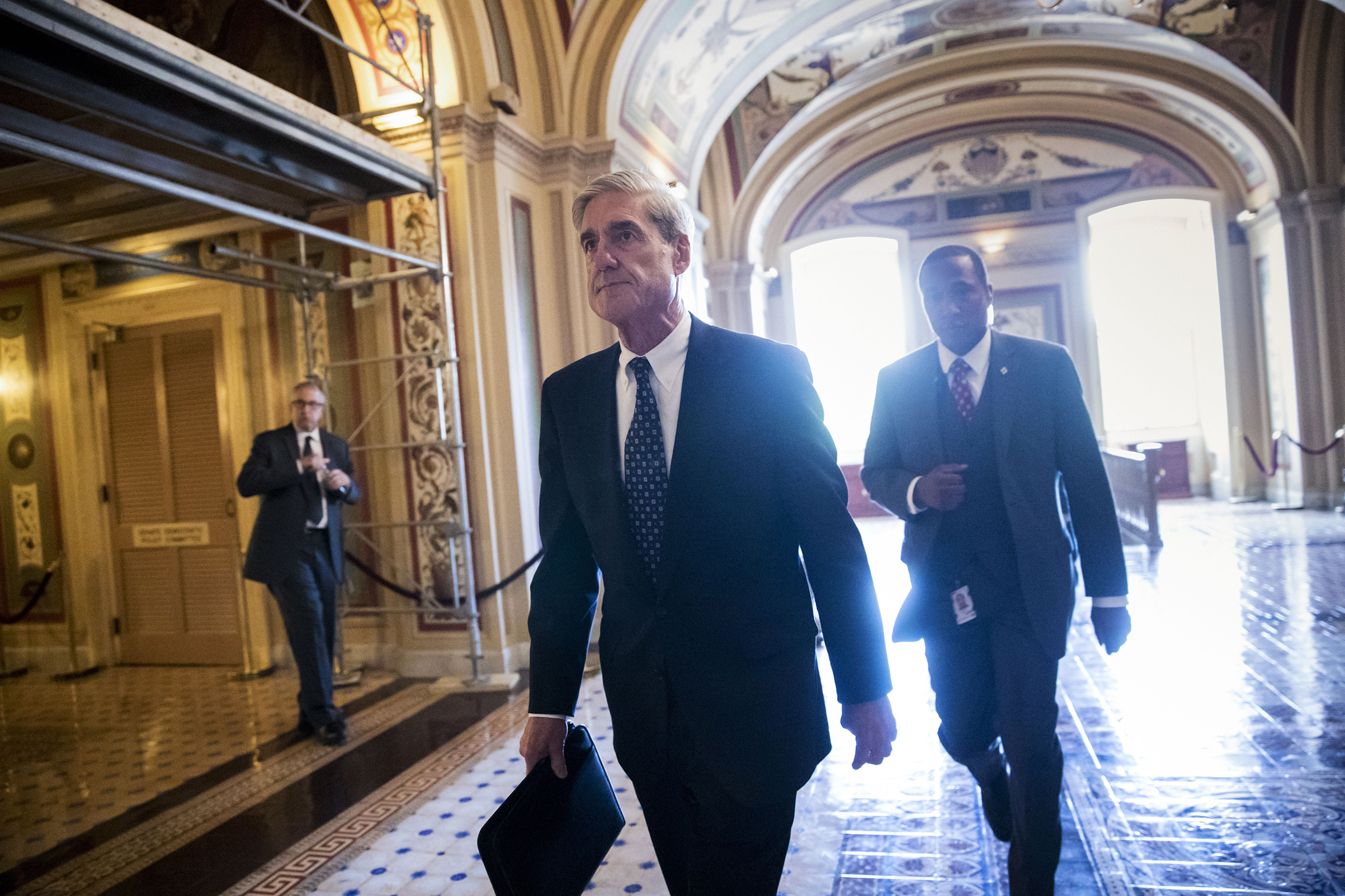 Mueller leaves the Capitol after briefing Senators in June 2017