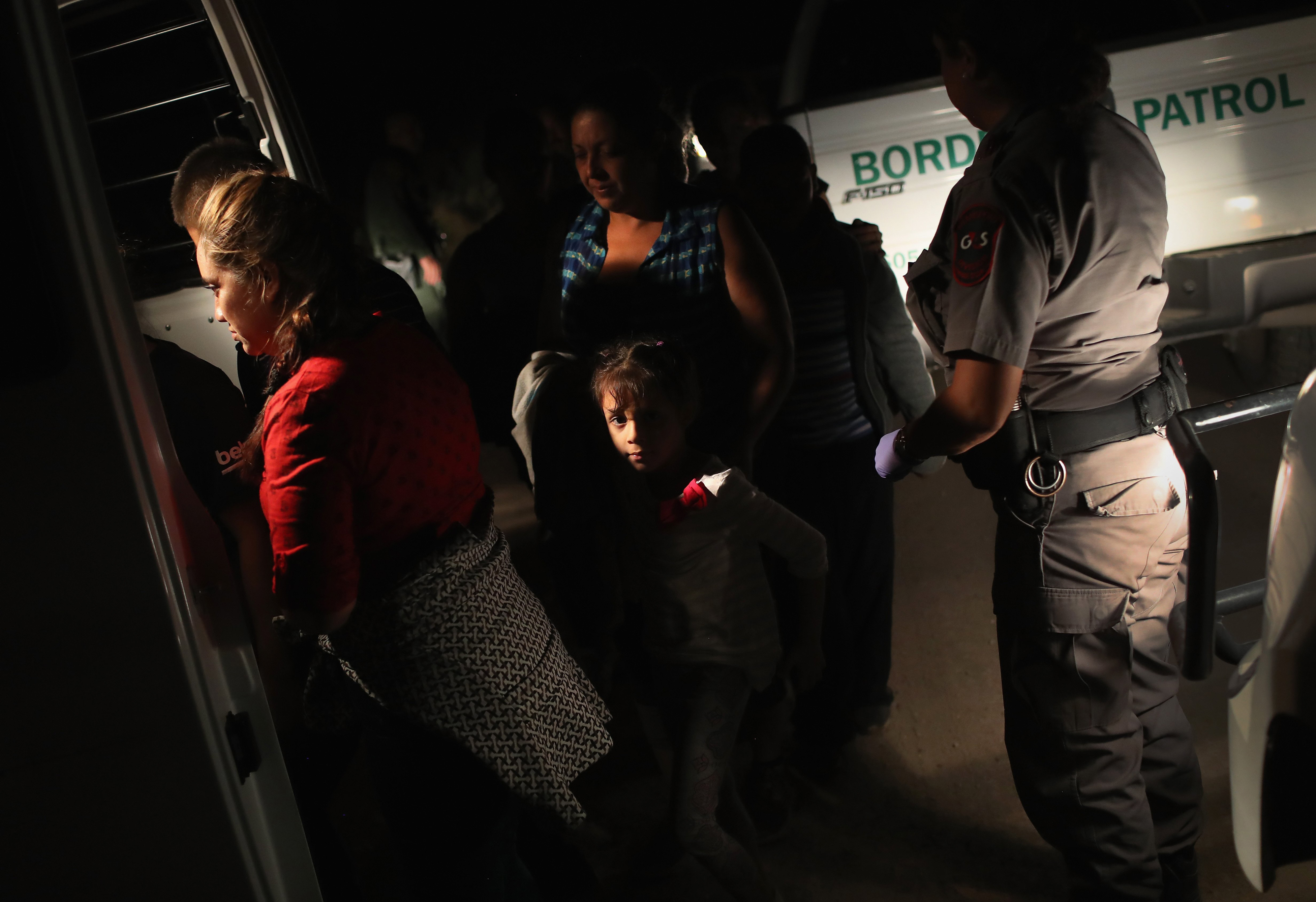 U.S. Border Patrol agents detain a group of Central American asylum seekers near the U.S.-Mexico border in McAllen, Texas on June 12, 2018.