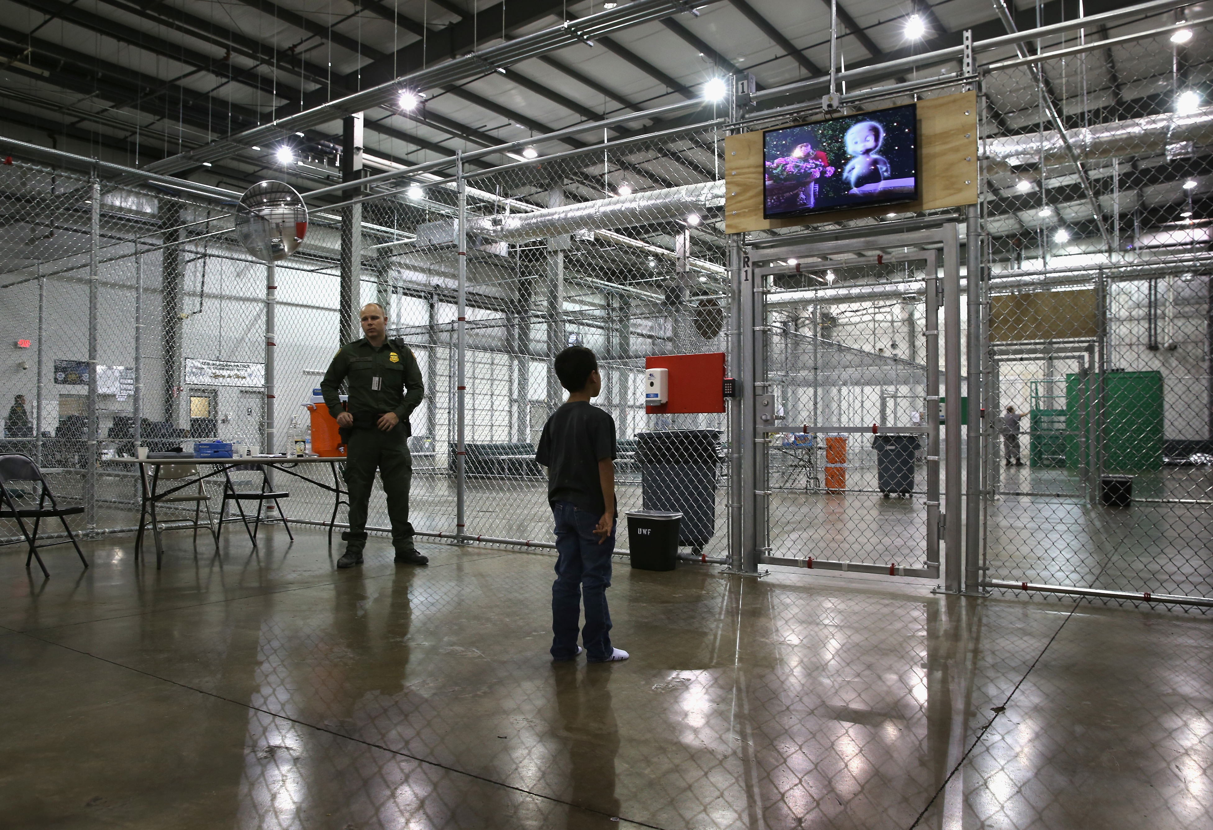 A boy from Honduras watches a movie at a detention facility run by the U.S. Border Patrol in McAllen, Tex. on Sept. 8, 2014.