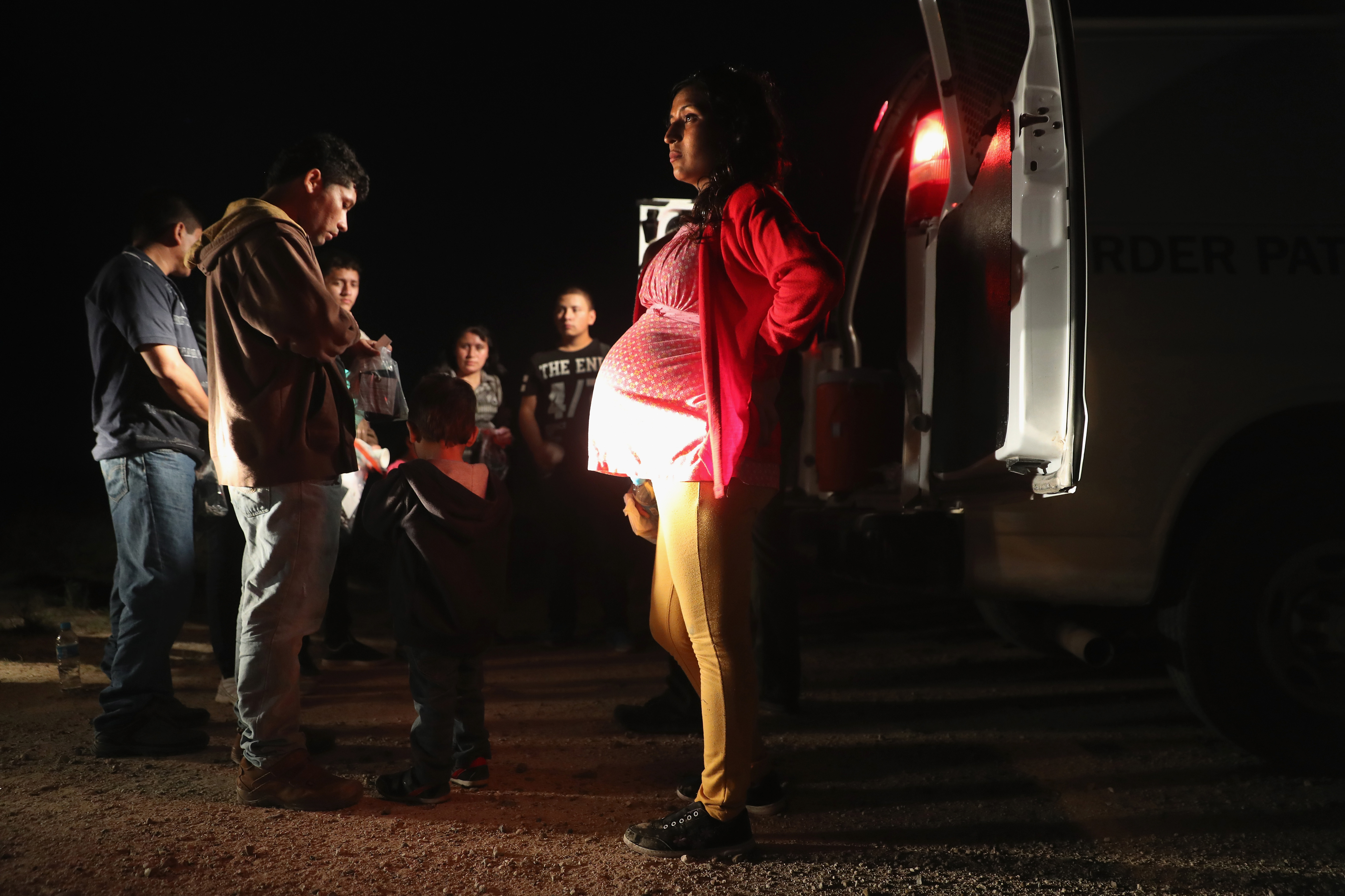 Immigrants from Central America wait to be taken into custody by U.S. Border Patrol agents in Roma, Texas on August 17, 2016.