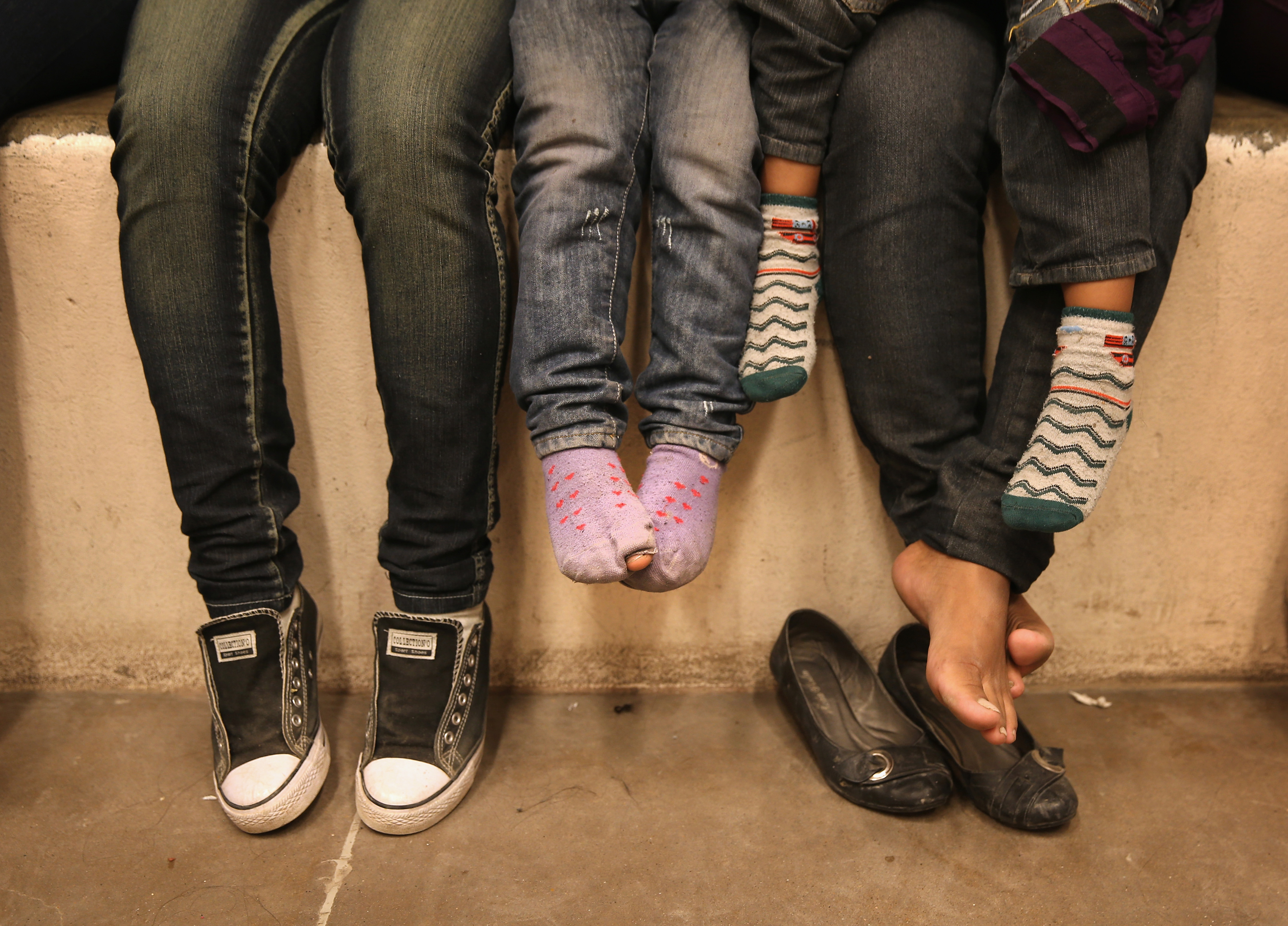 Women and children sit in a holding cell at a U.S. Border Patrol processing center after being detained by agents near the U.S.-Mexico border near McAllen, Texas on Sept. 8, 2014.