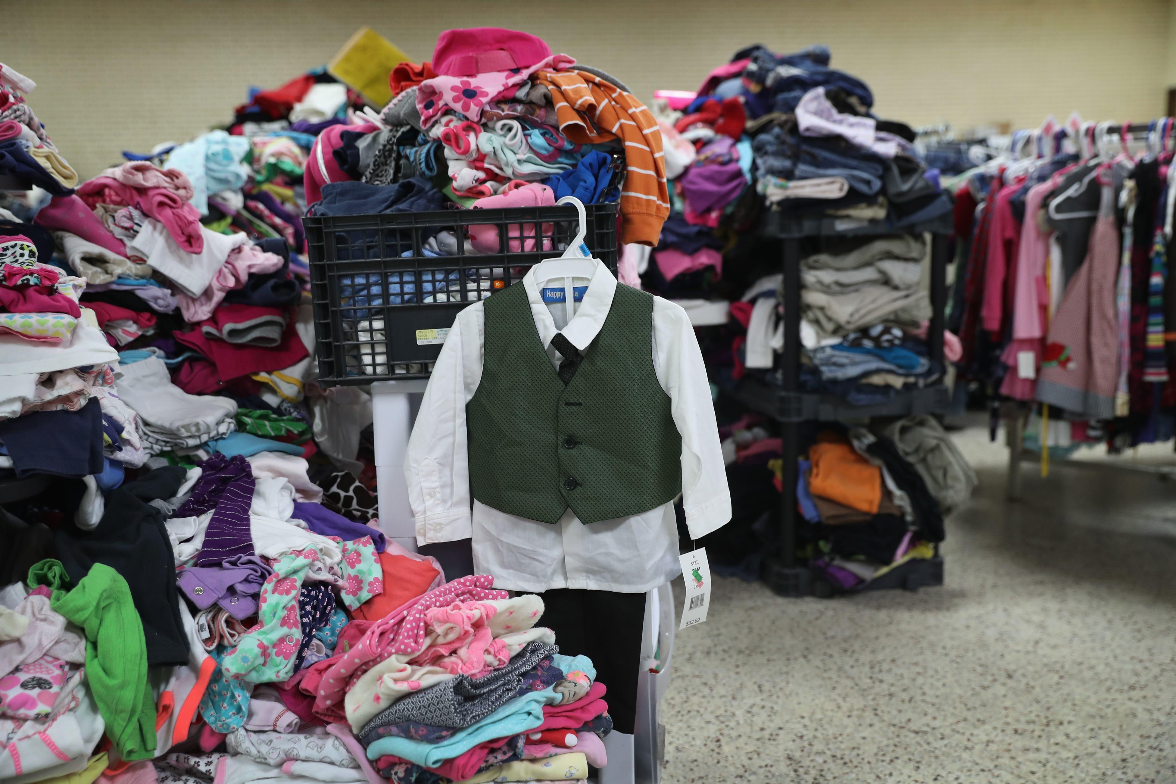Donated clothing await immigrants at the Catholic Sacred Heart Church Immigrant Respite Center from McAllen, Texas on Aug. 15, 2016.