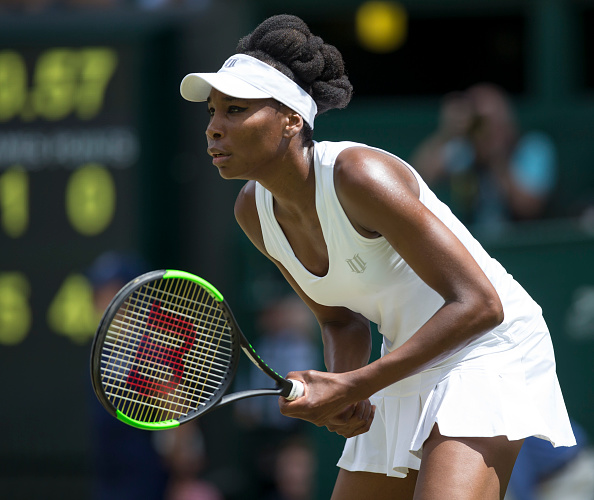 Venus Williams awaits a serve from Ana Konjuh at Wimbledon 2017.