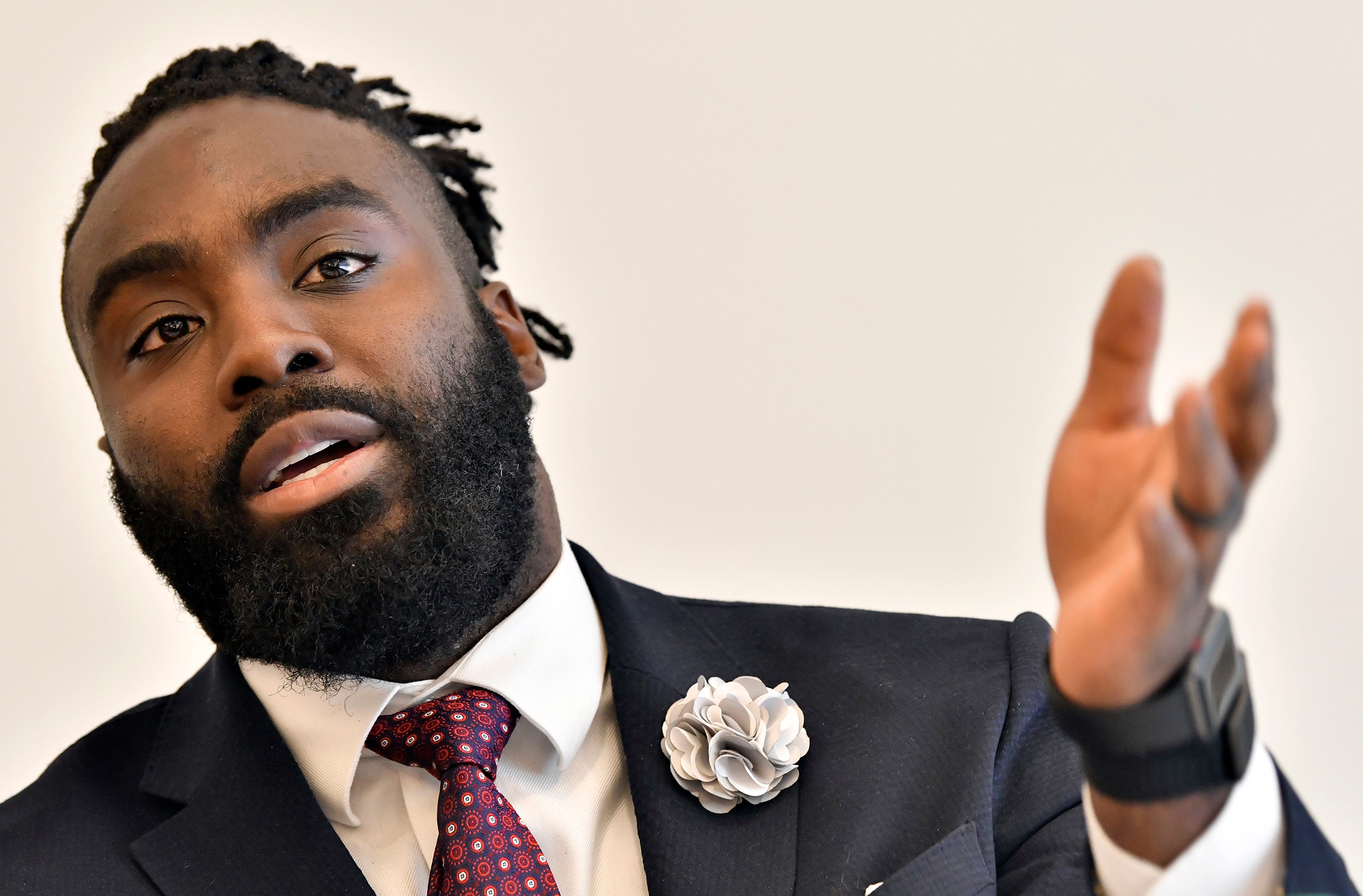 New Orleans Saints' Demario Davis discusses criminal justice issues with other current and former NFL football players at Harvard Law School, in Cambridge, Mass. on March 23, 2018.