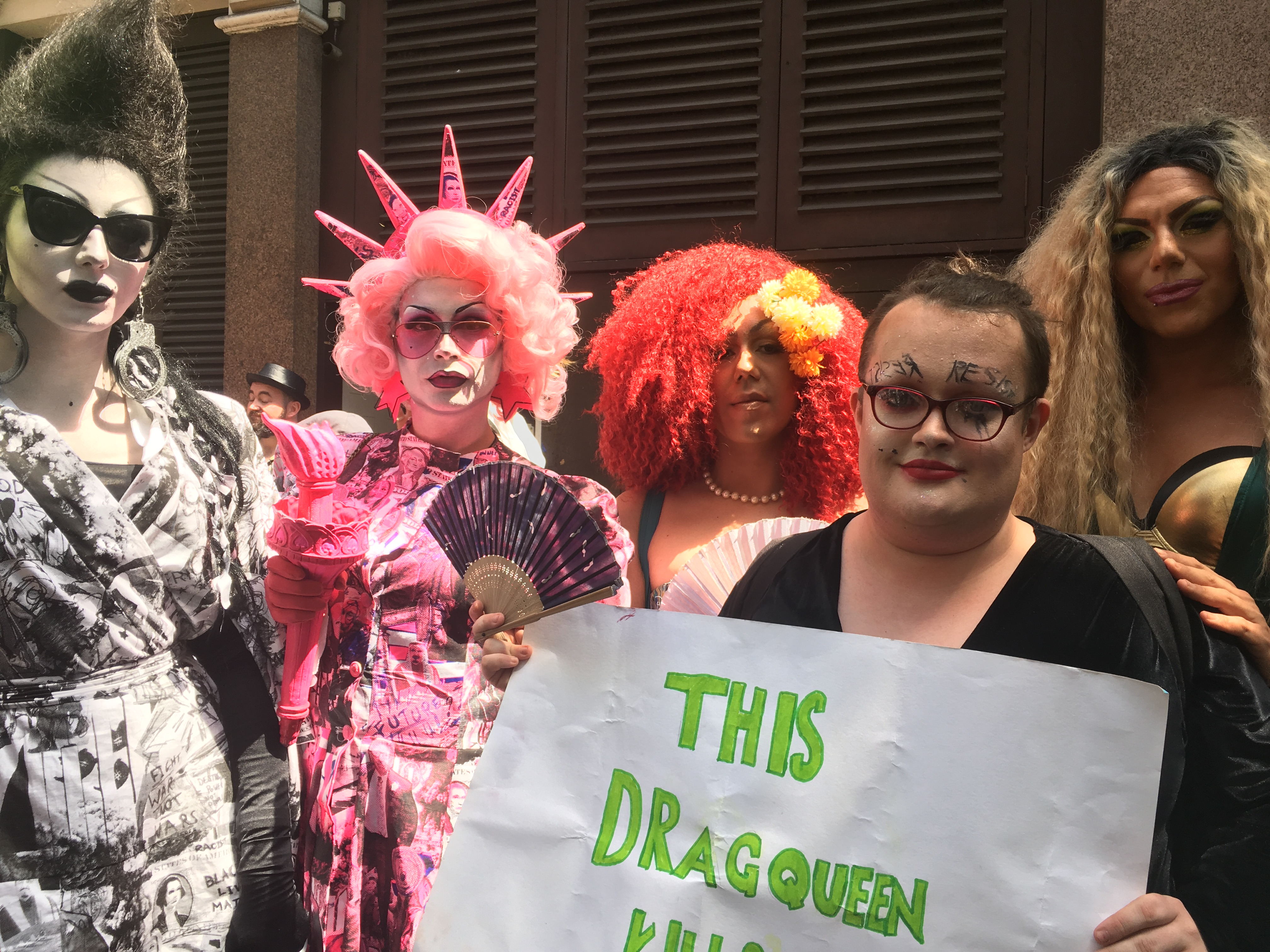 Drag queens, including Liquorice Black (far left), Maryanne Misandry (front centre) and Very Berry (far right), gather to protest Trump's visit in Soho, central London on July 13.