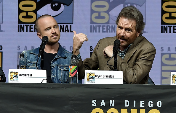 Aaron Paul (L) and Bryan Cranston speak onstage during the 'Breaking Bad' 10th Anniversary Celebration during Comic-Con International 2018 on July 19, 2018 in San Diego, California.