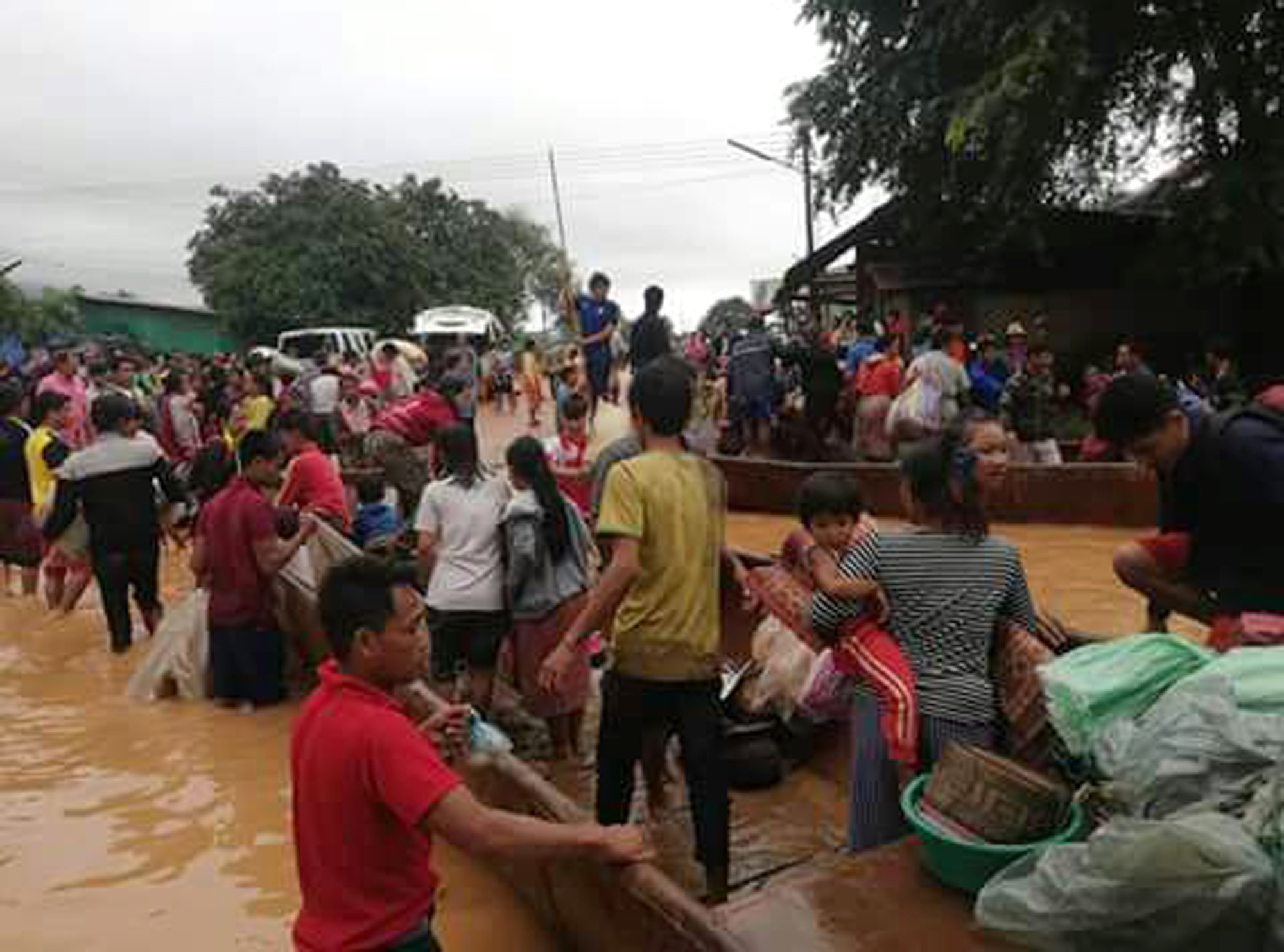 People are evacuated on July 24, 2018 after a dam collapsed in Laos.