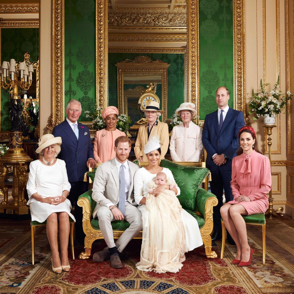 This official handout Christening photograph released by the Duke and Duchess of Sussex shows Britain's Prince Harry, Duke of Sussex (centre left), and his wife Meghan, Duchess of Sussex holding their baby son, Archie Harrison Mountbatten-Windsor flanked by (L-R) Britain's Camilla, Duchess of Cornwall, Britain's Prince Charles, Prince of Wales, Ms Doria Ragland, Lady Jane Fellowes, Lady Sarah McCorquodale, Britain's Prince William, Duke of Cambridge, and Britain's Catherine, Duchess of Cambridge in the Green Drawing Room at Windsor Castle, west of London on July 6, 2019.